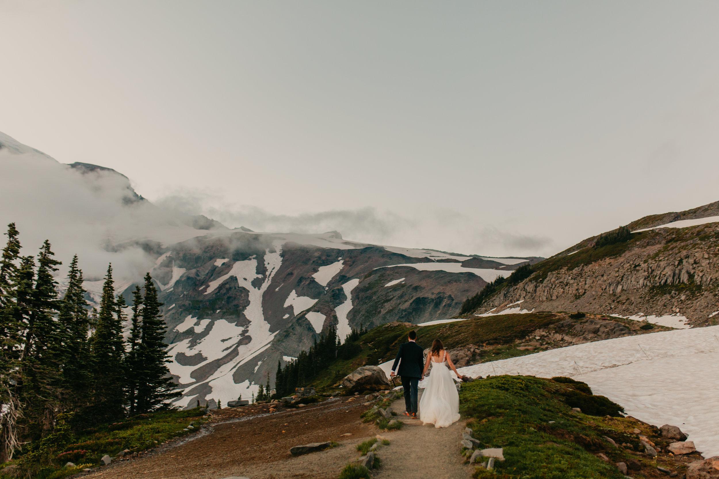 Nicole-Daacke-Photography-Mt-Rainier-elopement-photographer-washington-mountain-epic-wedding-photography-wildflowers-at-rainier-pine-tree-cloudy-summer-day-at-mountain-rainier-71.jpg