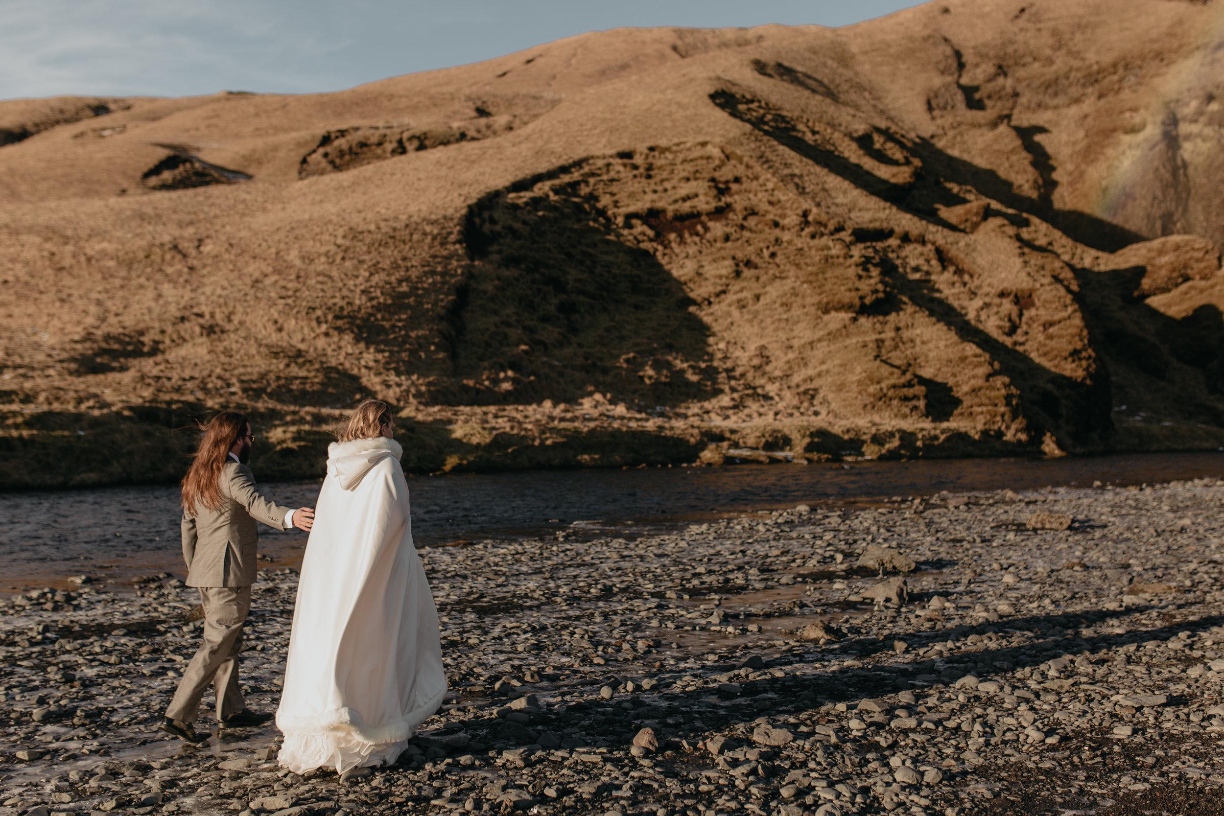 nicole-daacke-photography-iceland-winter-sunset-adventure-elopement-skogafoss-waterfall-black-sand-beach-dyrholaey-vik-iceland-intimate-wedding-black-church-elopement-photographer-2.jpg