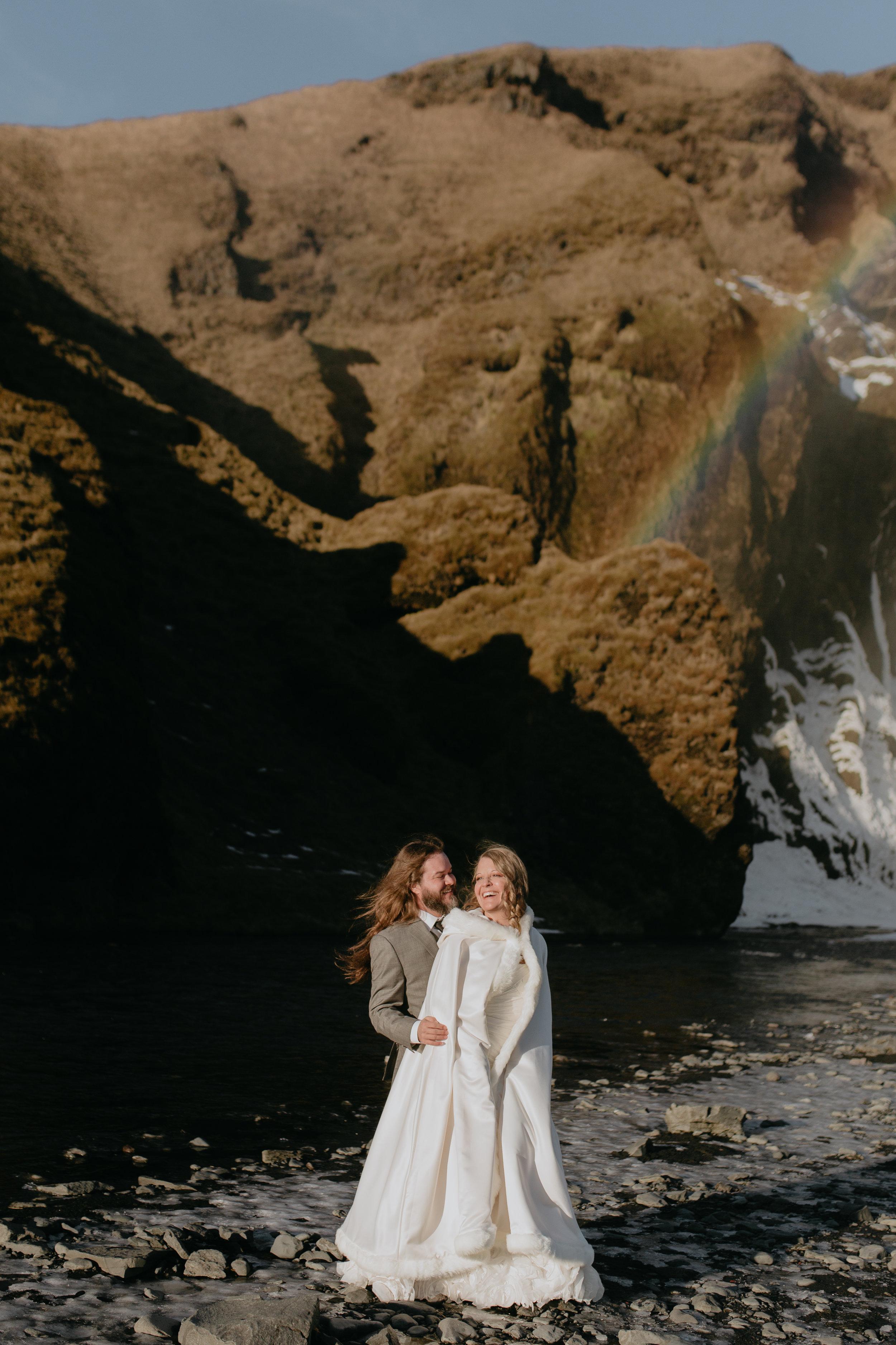 nicole-daacke-photography-iceland-winter-sunset-adventure-elopement-skogafoss-waterfall-black-sand-beach-dyrholaey-vik-iceland-intimate-wedding-black-church-elopement-photographer-4.jpg