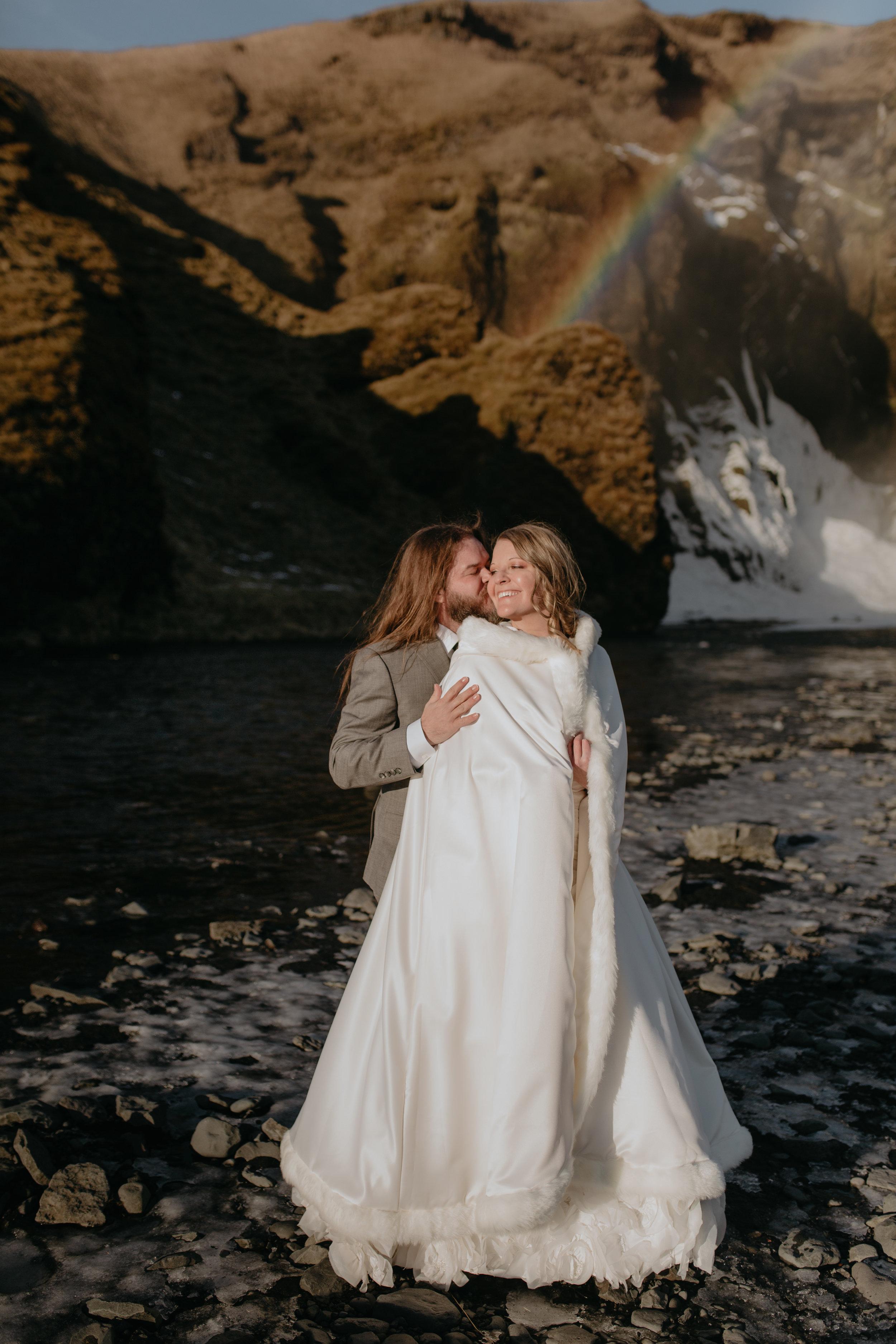 nicole-daacke-photography-iceland-winter-sunset-adventure-elopement-skogafoss-waterfall-black-sand-beach-dyrholaey-vik-iceland-intimate-wedding-black-church-elopement-photographer-3.jpg