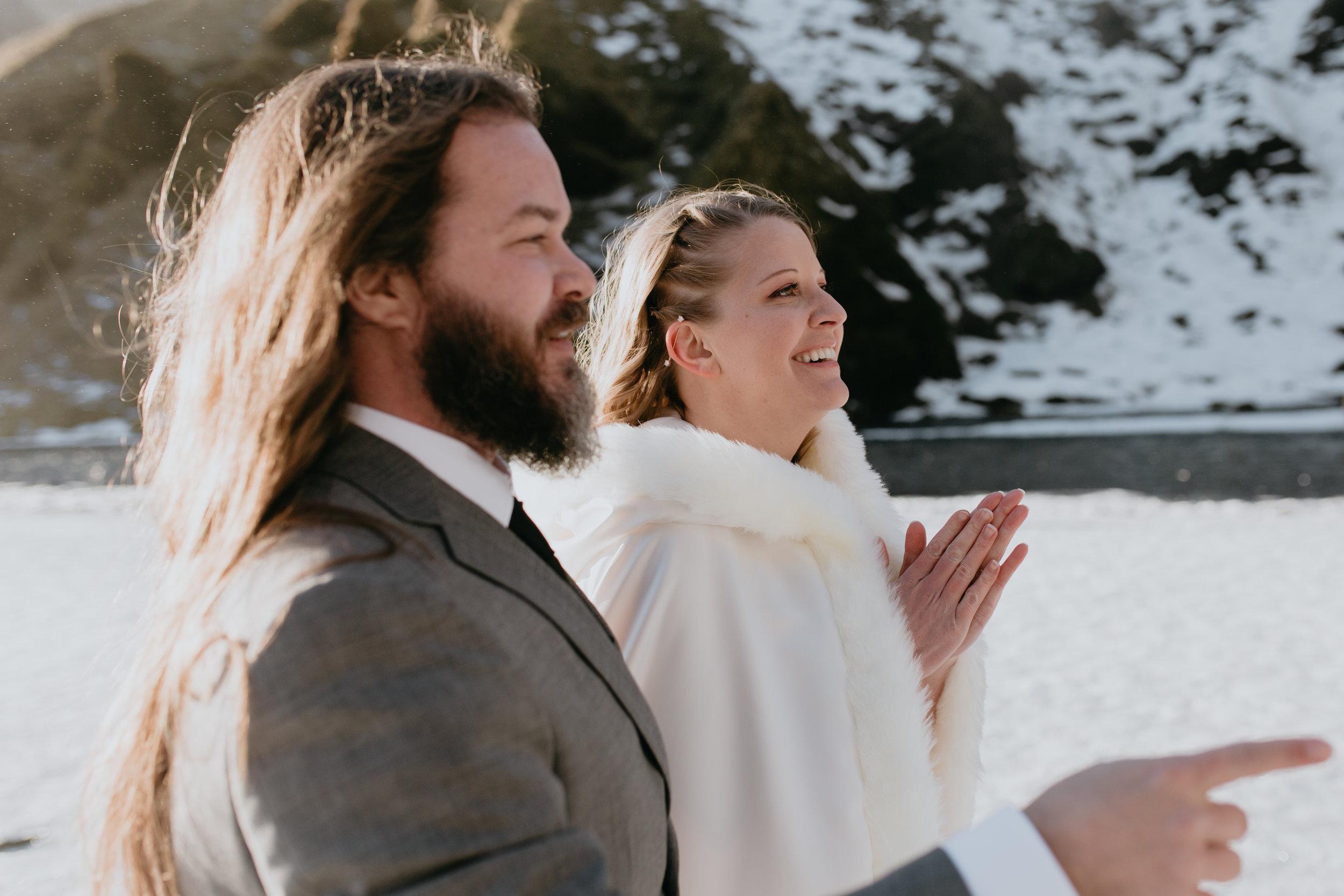 nicole-daacke-photography-iceland-winter-sunset-adventure-elopement-skogafoss-waterfall-black-sand-beach-dyrholaey-vik-iceland-intimate-wedding-black-church-elopement-photographer-7.jpg