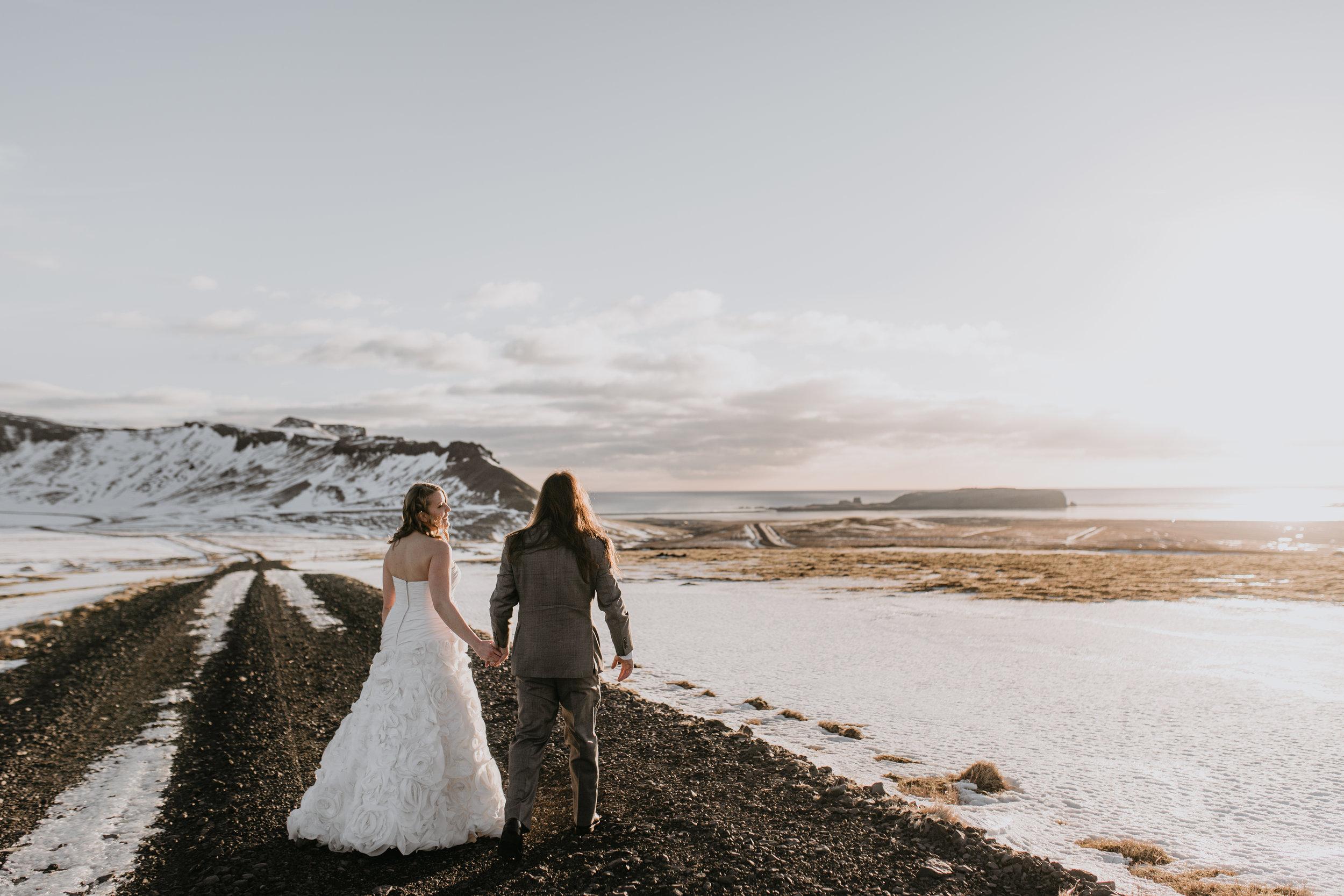 nicole-daacke-photography-iceland-winter-sunset-adventure-elopement-skogafoss-waterfall-black-sand-beach-dyrholaey-vik-iceland-intimate-wedding-black-church-elopement-photographer-13.jpg