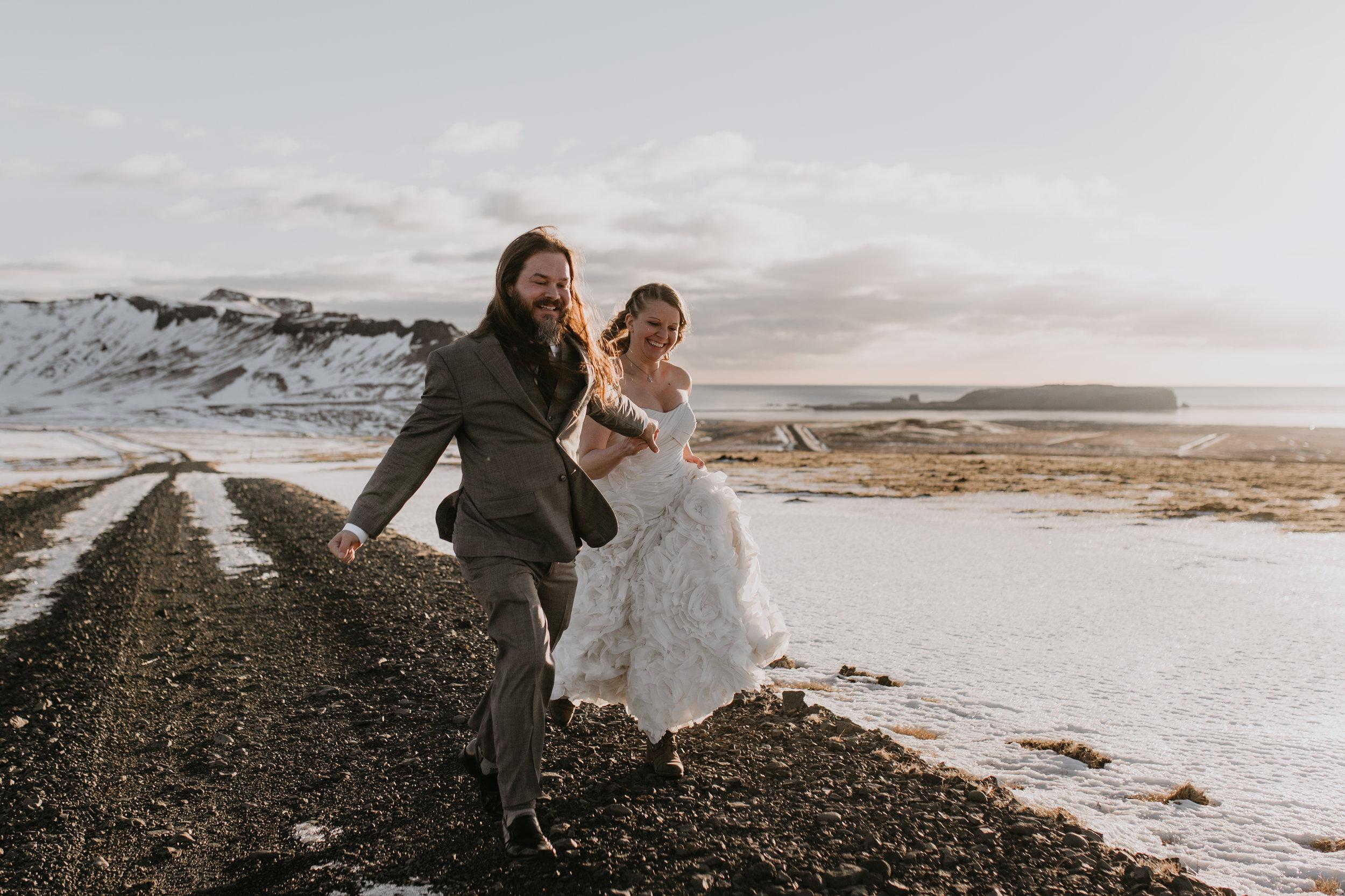 nicole-daacke-photography-iceland-winter-sunset-adventure-elopement-skogafoss-waterfall-black-sand-beach-dyrholaey-vik-iceland-intimate-wedding-black-church-elopement-photographer-15.jpg