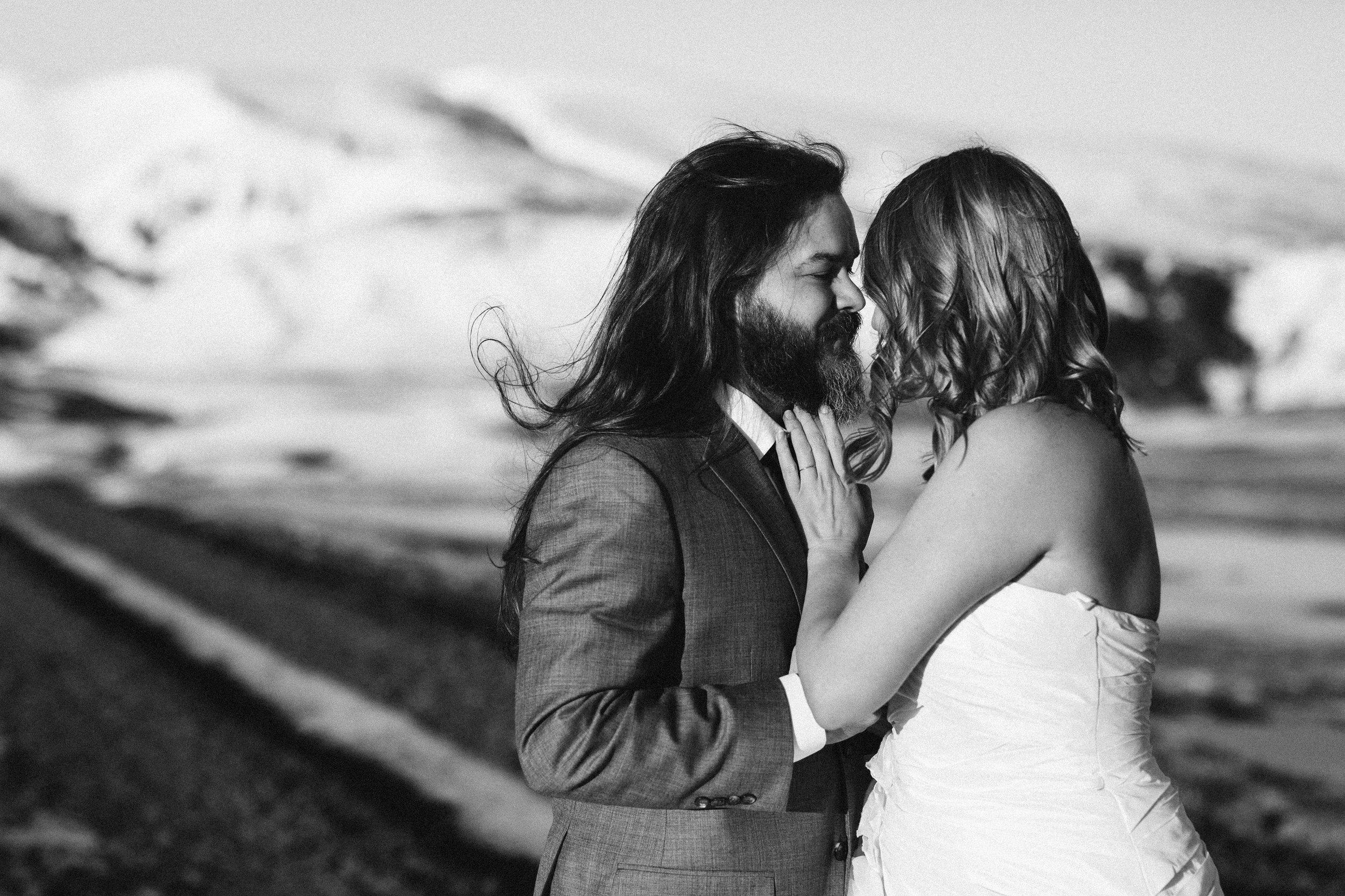 nicole-daacke-photography-iceland-winter-sunset-adventure-elopement-skogafoss-waterfall-black-sand-beach-dyrholaey-vik-iceland-intimate-wedding-black-church-elopement-photographer-19.jpg