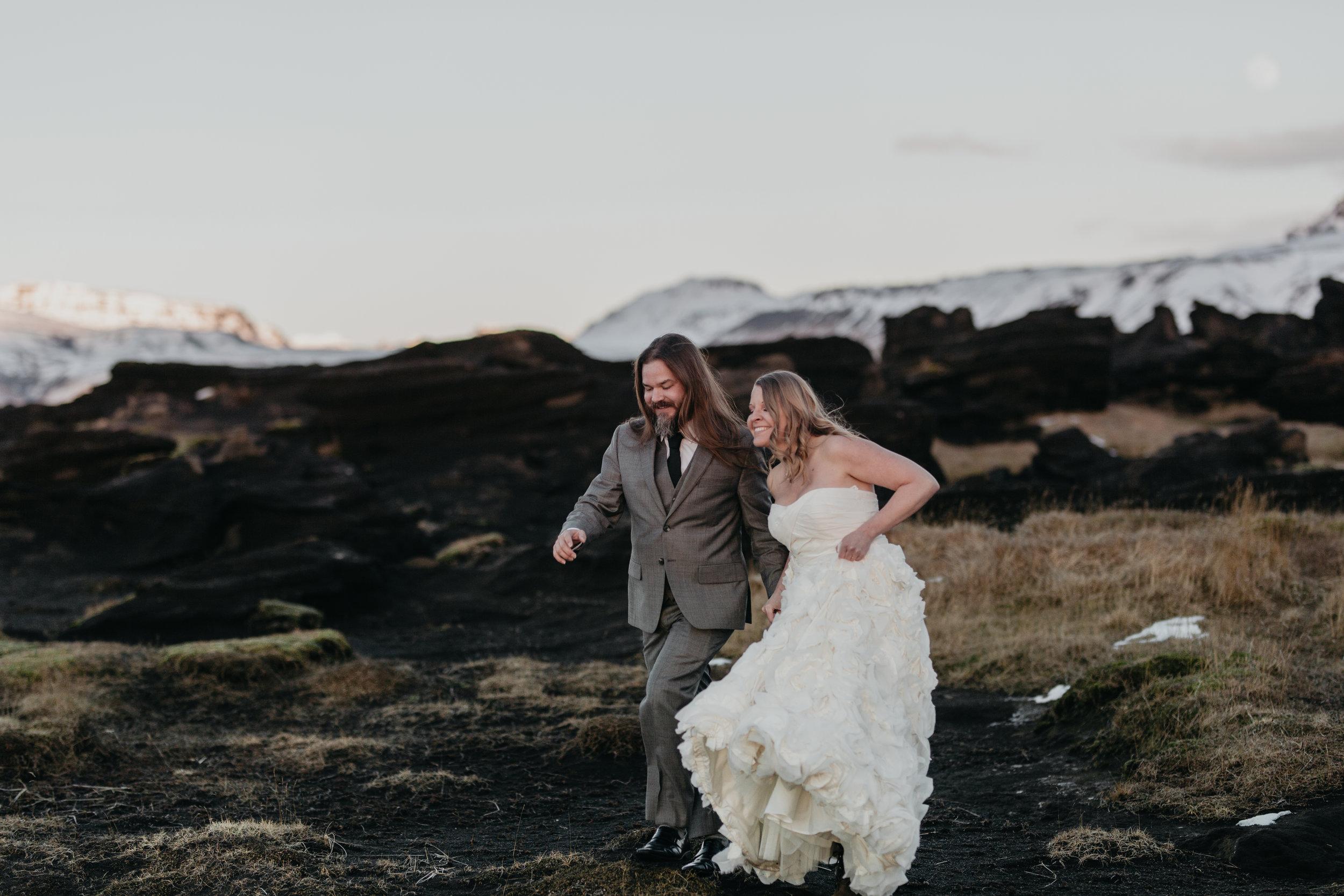 nicole-daacke-photography-iceland-winter-sunset-adventure-elopement-skogafoss-waterfall-black-sand-beach-dyrholaey-vik-iceland-intimate-wedding-black-church-elopement-photographer-28.jpg