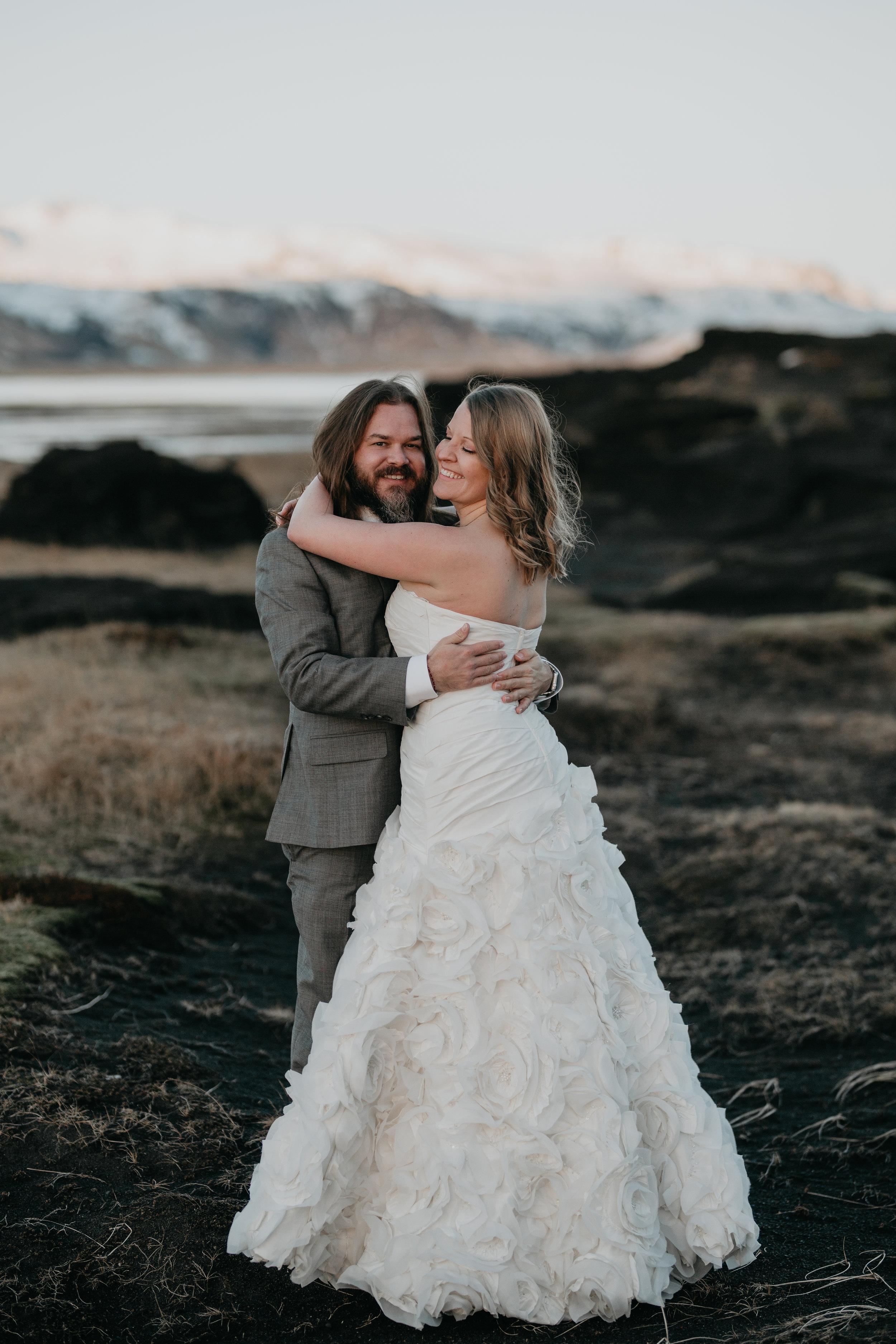 nicole-daacke-photography-iceland-winter-sunset-adventure-elopement-skogafoss-waterfall-black-sand-beach-dyrholaey-vik-iceland-intimate-wedding-black-church-elopement-photographer-30.jpg