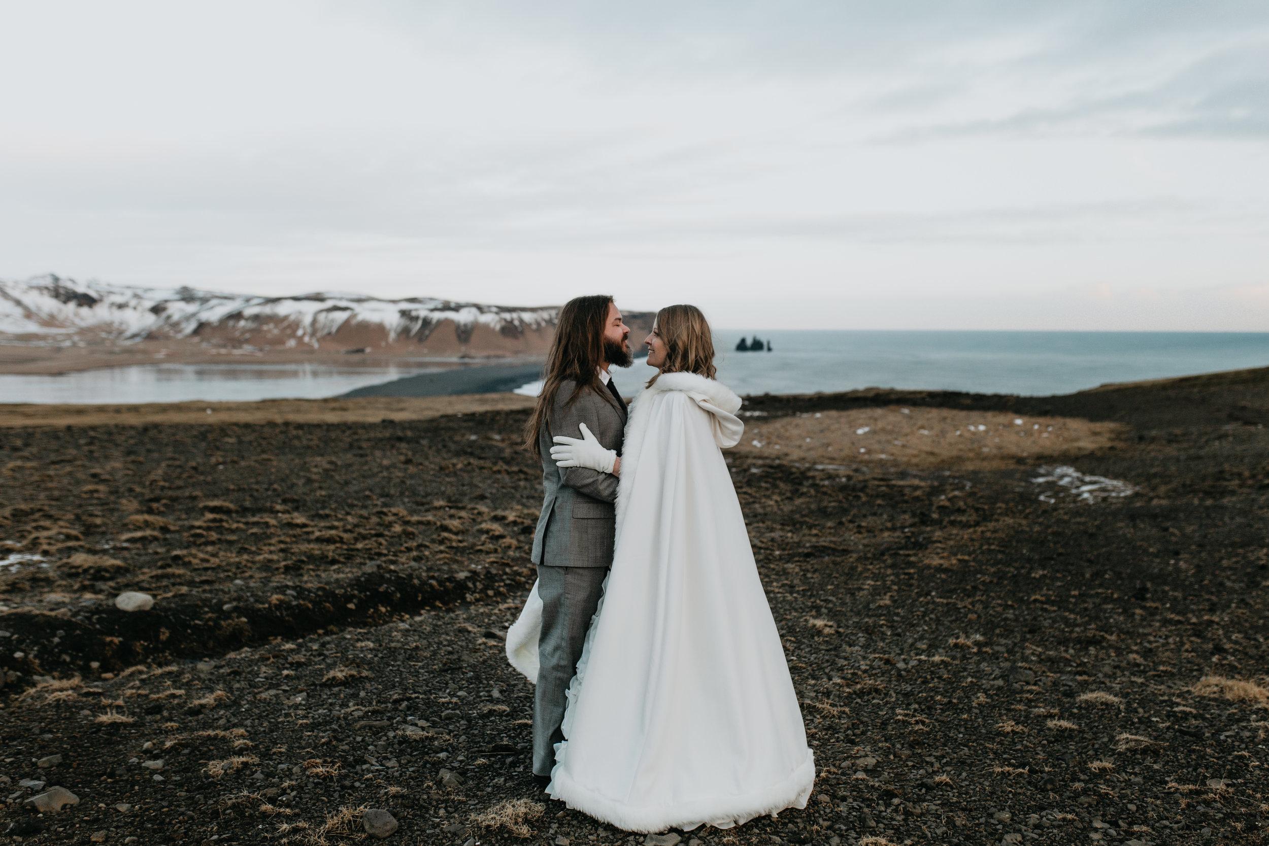 nicole-daacke-photography-iceland-winter-sunset-adventure-elopement-skogafoss-waterfall-black-sand-beach-dyrholaey-vik-iceland-intimate-wedding-black-church-elopement-photographer-34.jpg