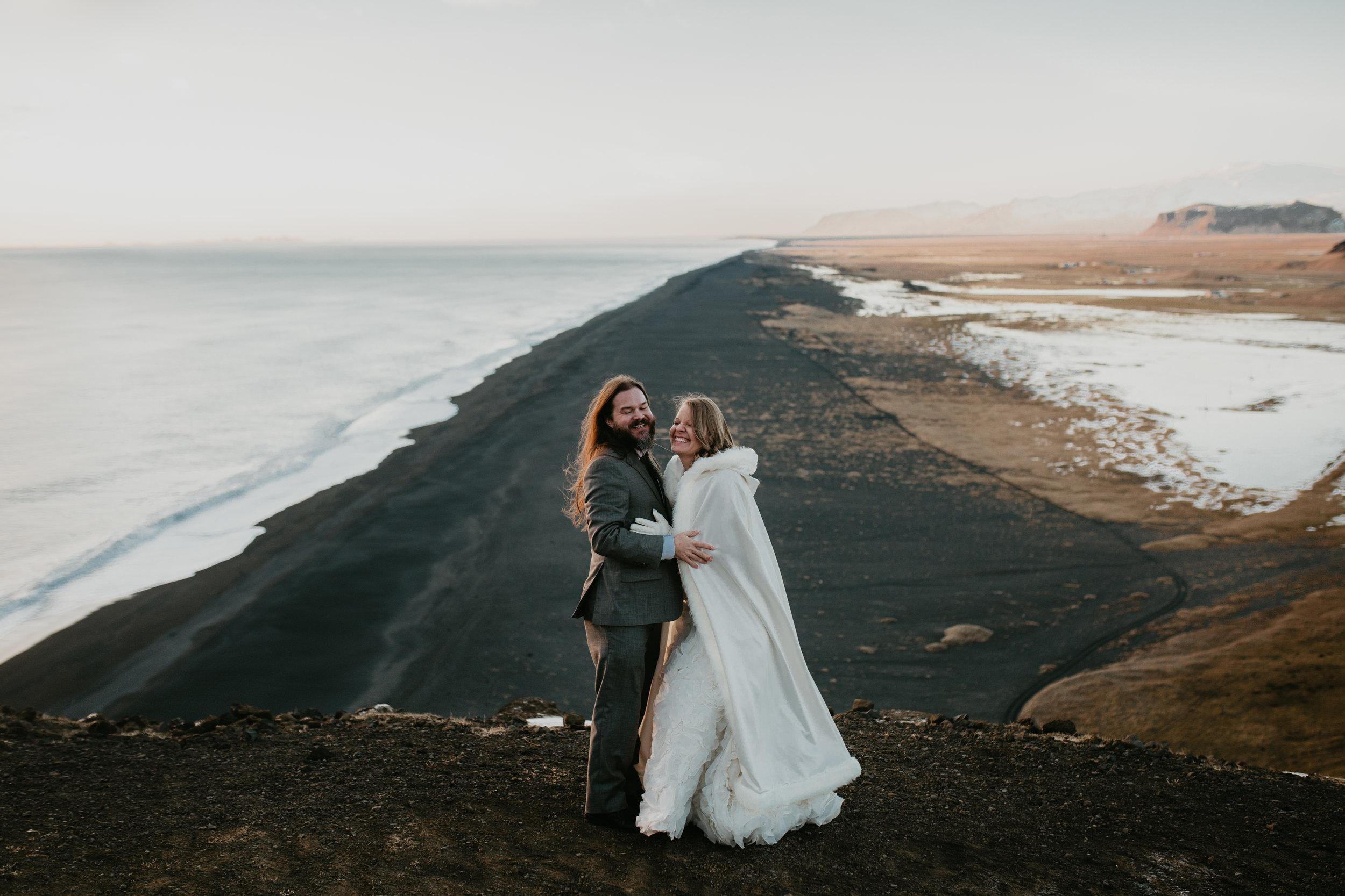 nicole-daacke-photography-iceland-winter-sunset-adventure-elopement-skogafoss-waterfall-black-sand-beach-dyrholaey-vik-iceland-intimate-wedding-black-church-elopement-photographer-38.jpg