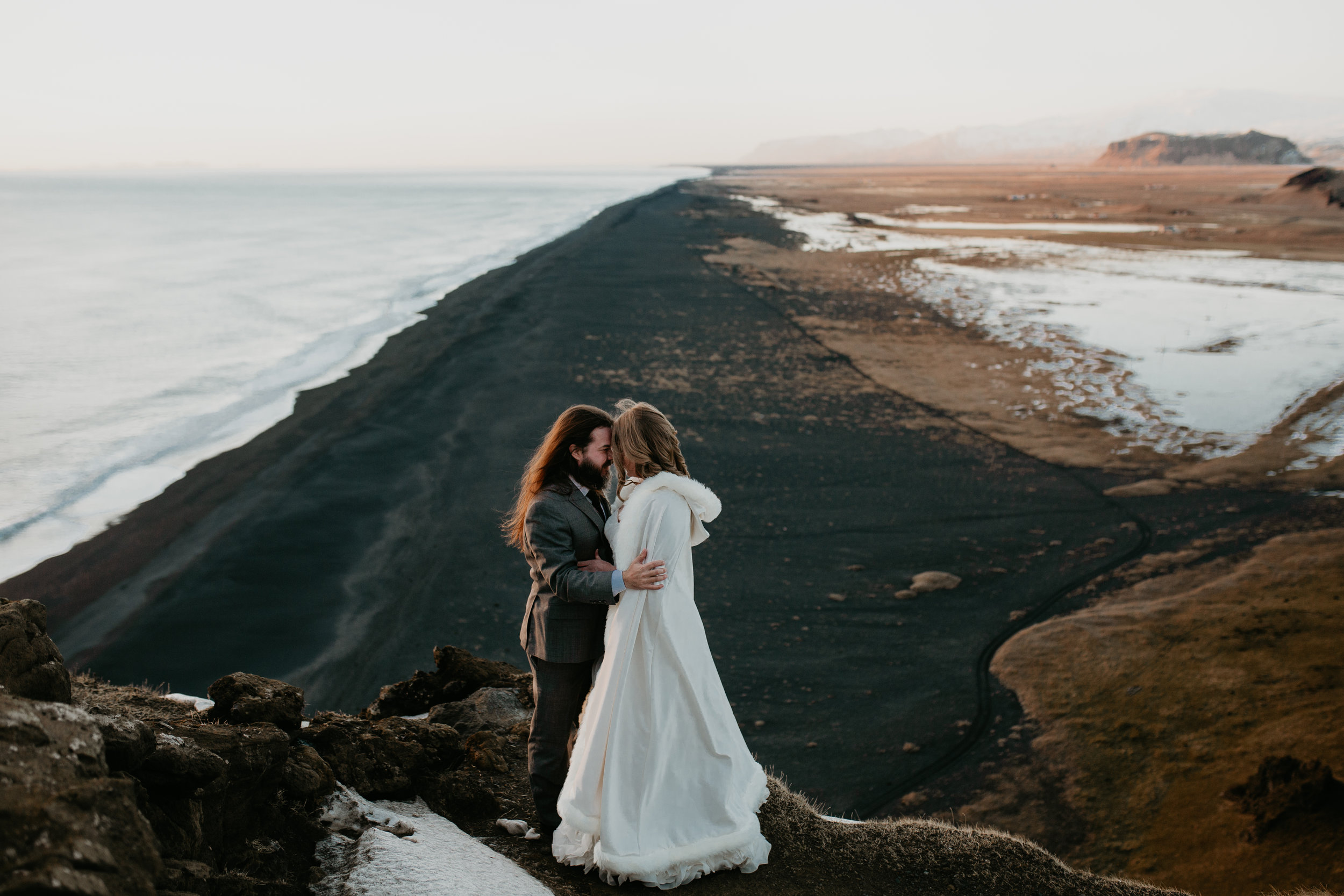 nicole-daacke-photography-iceland-winter-sunset-adventure-elopement-skogafoss-waterfall-black-sand-beach-dyrholaey-vik-iceland-intimate-wedding-black-church-elopement-photographer-40.jpg