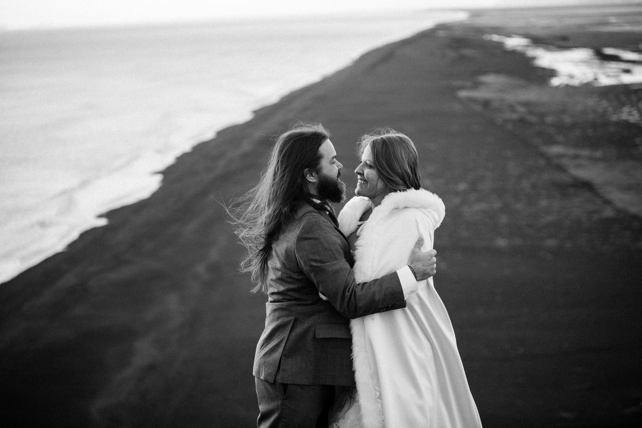 nicole-daacke-photography-iceland-winter-sunset-adventure-elopement-skogafoss-waterfall-black-sand-beach-dyrholaey-vik-iceland-intimate-wedding-black-church-elopement-photographer-39.jpg