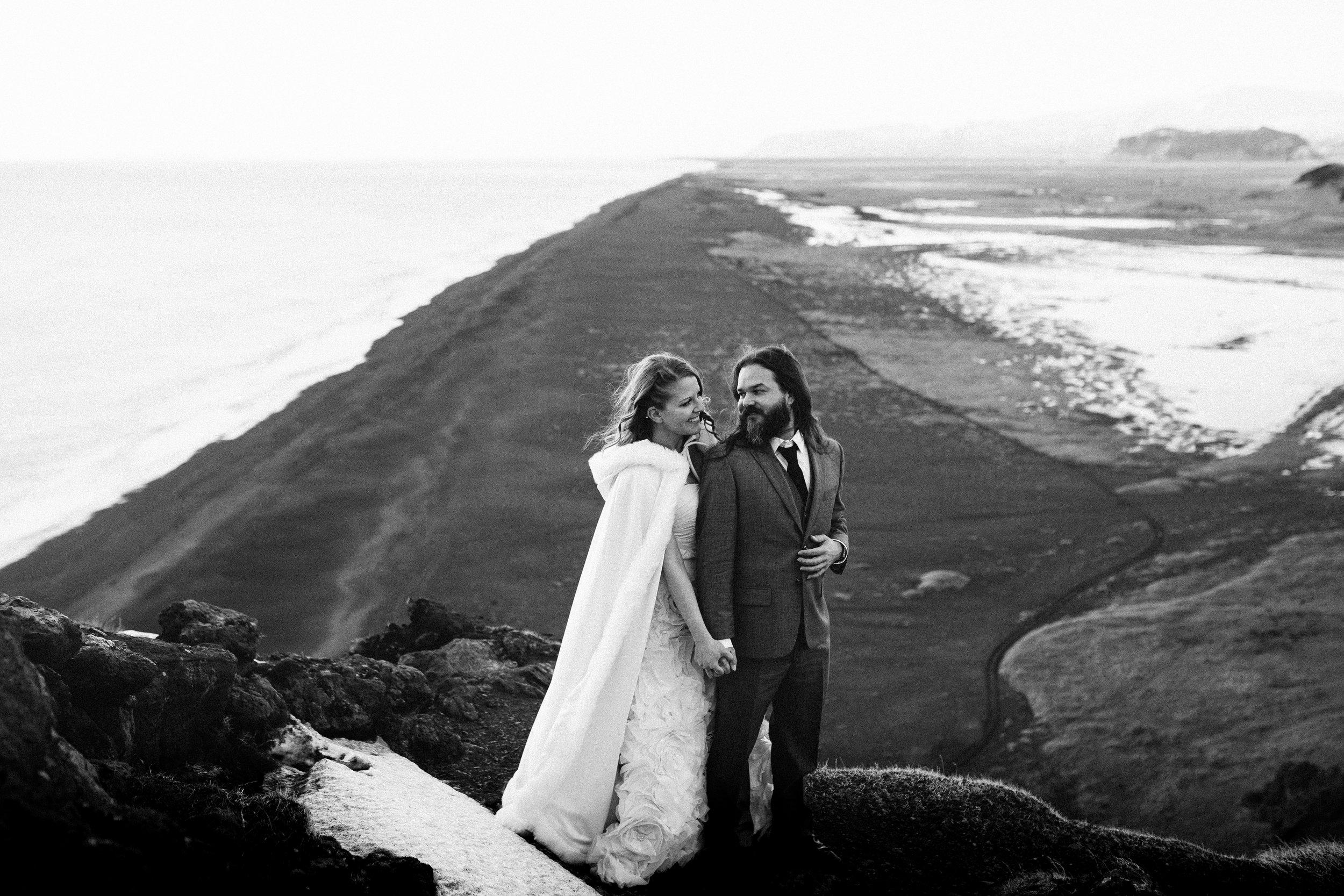 nicole-daacke-photography-iceland-winter-sunset-adventure-elopement-skogafoss-waterfall-black-sand-beach-dyrholaey-vik-iceland-intimate-wedding-black-church-elopement-photographer-41.jpg