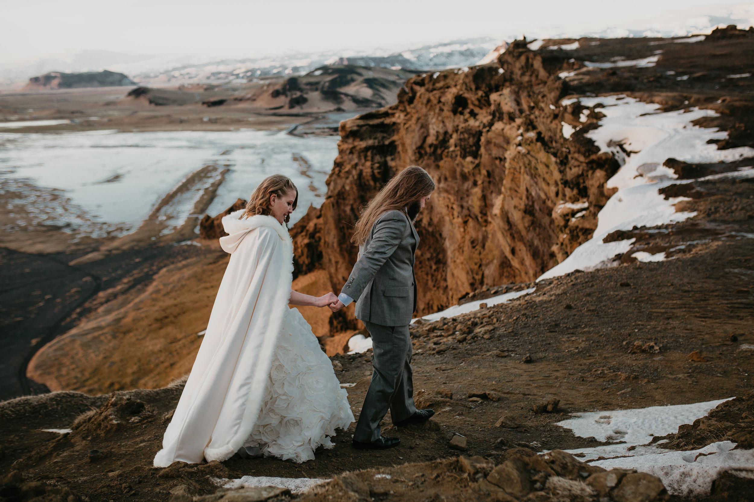 nicole-daacke-photography-iceland-winter-sunset-adventure-elopement-skogafoss-waterfall-black-sand-beach-dyrholaey-vik-iceland-intimate-wedding-black-church-elopement-photographer-43.jpg
