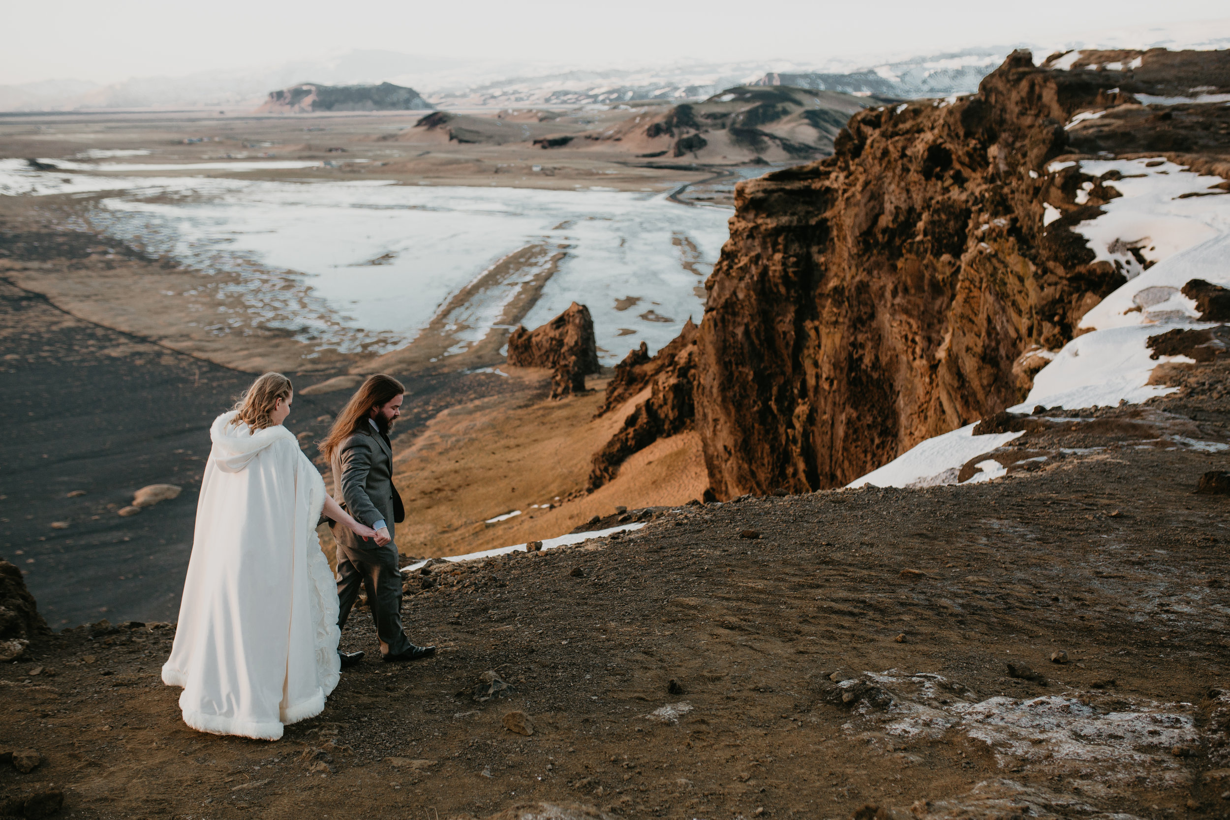 nicole-daacke-photography-iceland-winter-sunset-adventure-elopement-skogafoss-waterfall-black-sand-beach-dyrholaey-vik-iceland-intimate-wedding-black-church-elopement-photographer-44.jpg