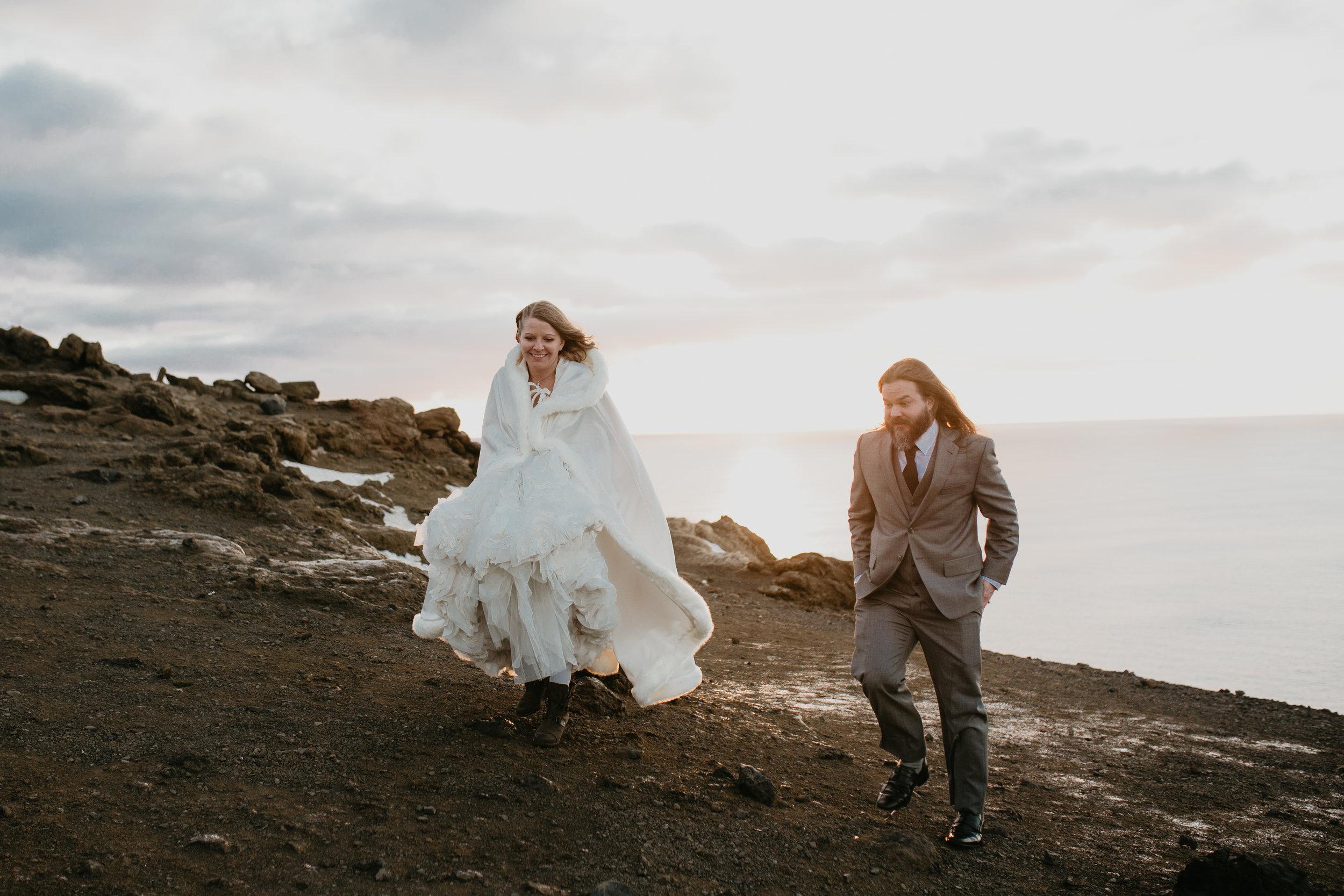 nicole-daacke-photography-iceland-winter-sunset-adventure-elopement-skogafoss-waterfall-black-sand-beach-dyrholaey-vik-iceland-intimate-wedding-black-church-elopement-photographer-45.jpg