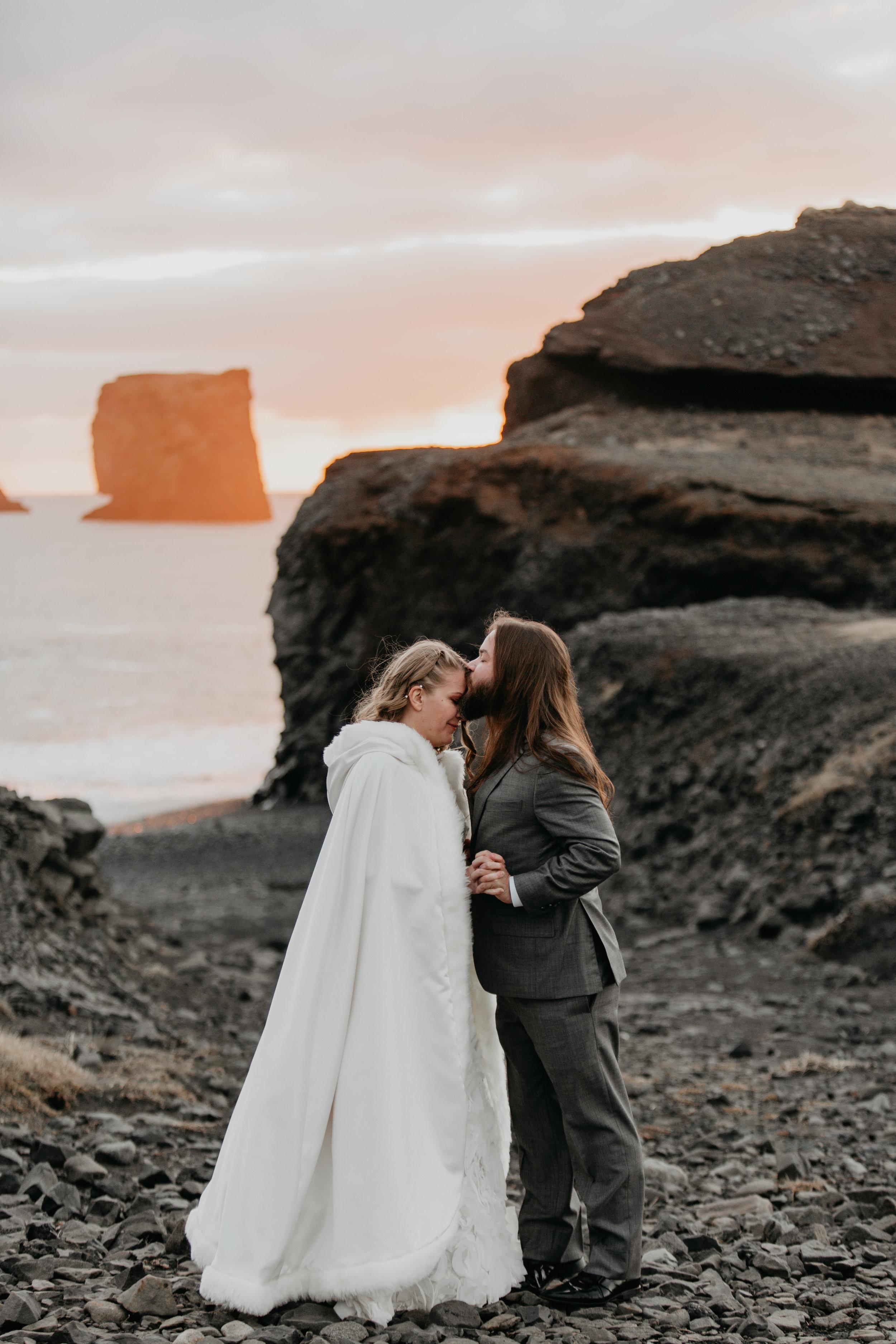 nicole-daacke-photography-iceland-winter-sunset-adventure-elopement-skogafoss-waterfall-black-sand-beach-dyrholaey-vik-iceland-intimate-wedding-black-church-elopement-photographer-47.jpg