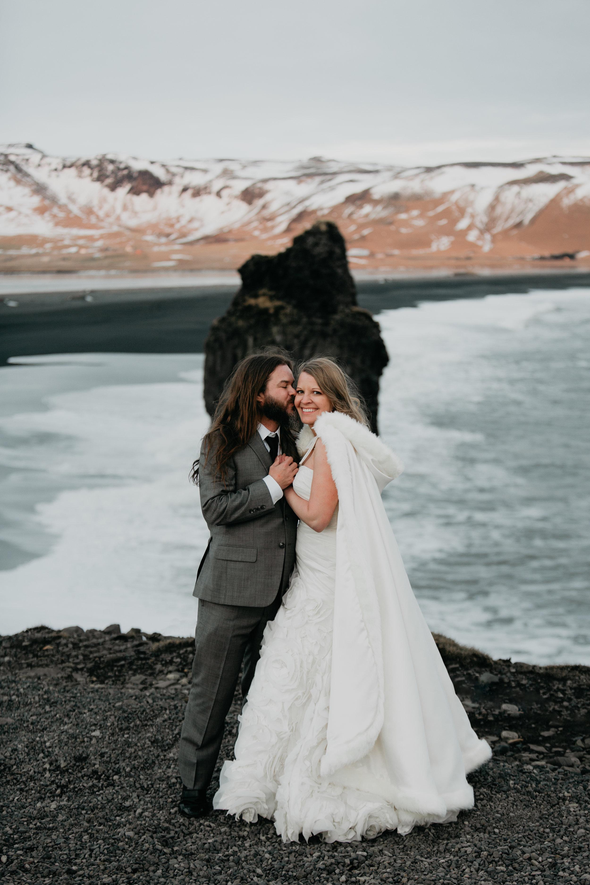 nicole-daacke-photography-iceland-winter-sunset-adventure-elopement-skogafoss-waterfall-black-sand-beach-dyrholaey-vik-iceland-intimate-wedding-black-church-elopement-photographer-48.jpg
