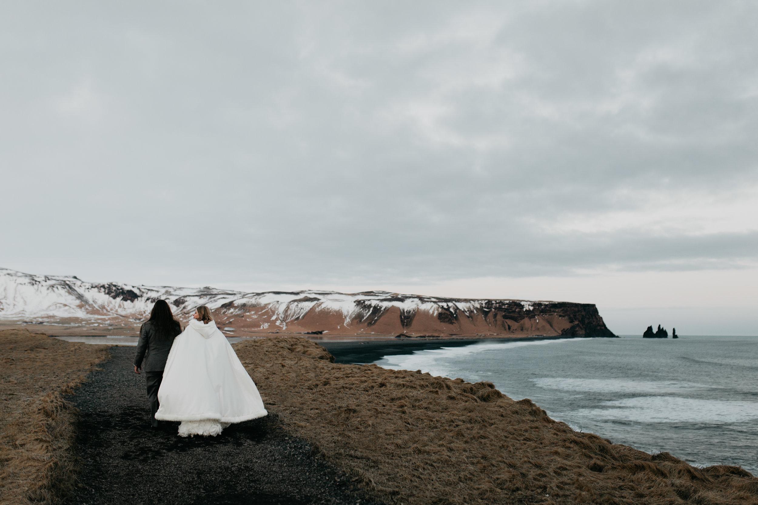 nicole-daacke-photography-iceland-winter-sunset-adventure-elopement-skogafoss-waterfall-black-sand-beach-dyrholaey-vik-iceland-intimate-wedding-black-church-elopement-photographer-52.jpg