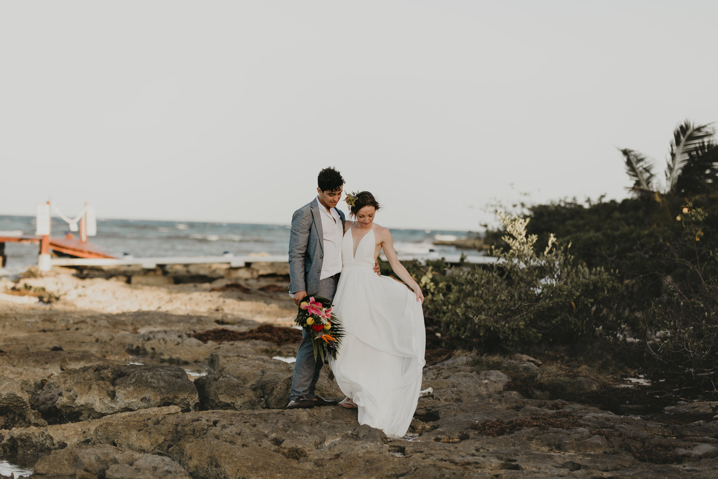 Nicole-Daacke-Photography-beachfront-akumal-destination-wedding-tulum-mexico-elopement-photographer-destination-wedding-inspiration-sunset-champagne-pop-boho-bride-ocean-tropical-bohemian-tulum-wedding-0830.jpg