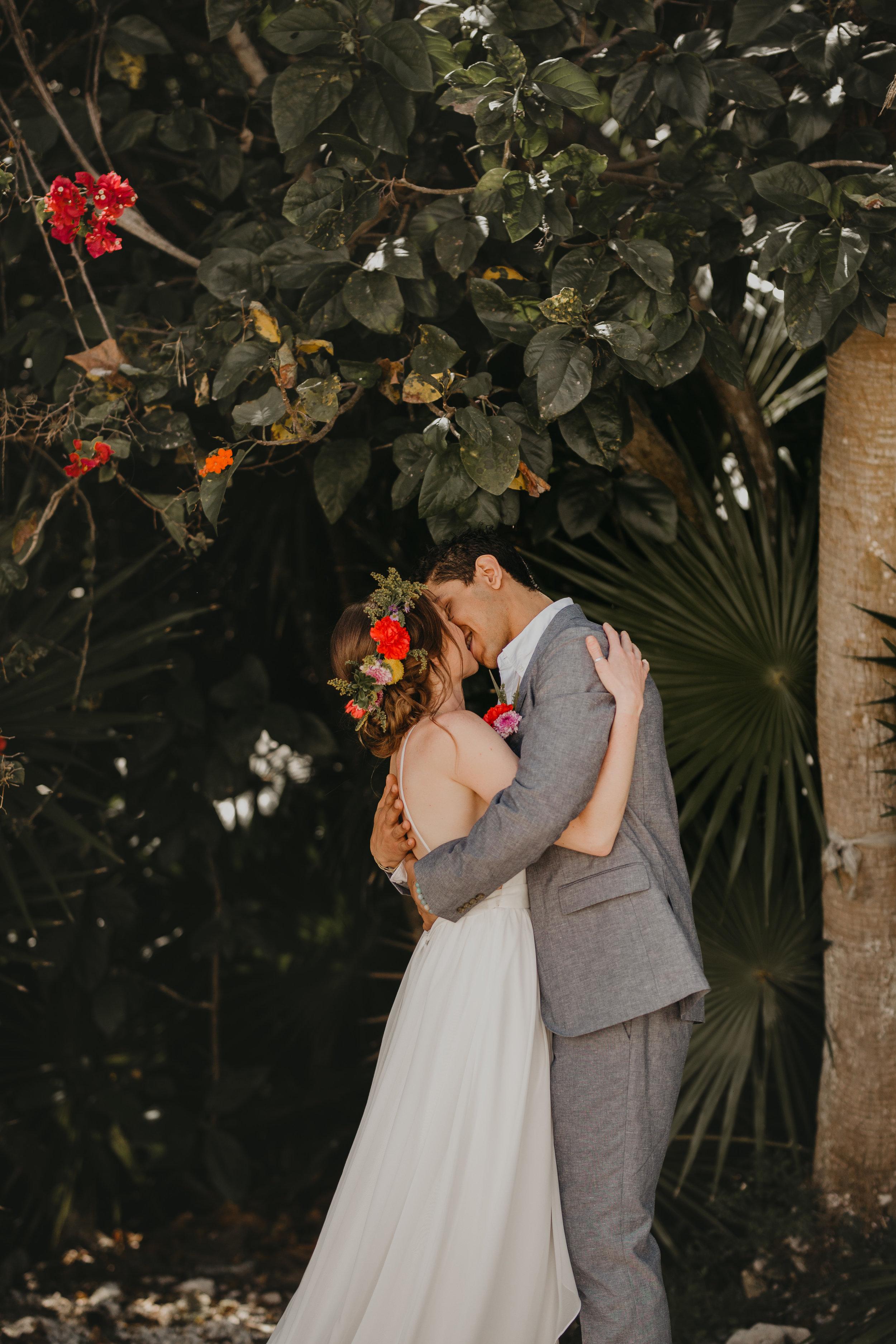 Nicole-Daacke-Photography-beachfront-akumal-destionation-wedding-tulum-mexico-elopement-photographer-destination-wedding-inspiration-sunset-champagne-pop-boho-bride-ocean-tropical-bohemian-tulum-wedding-photos-116.jpg