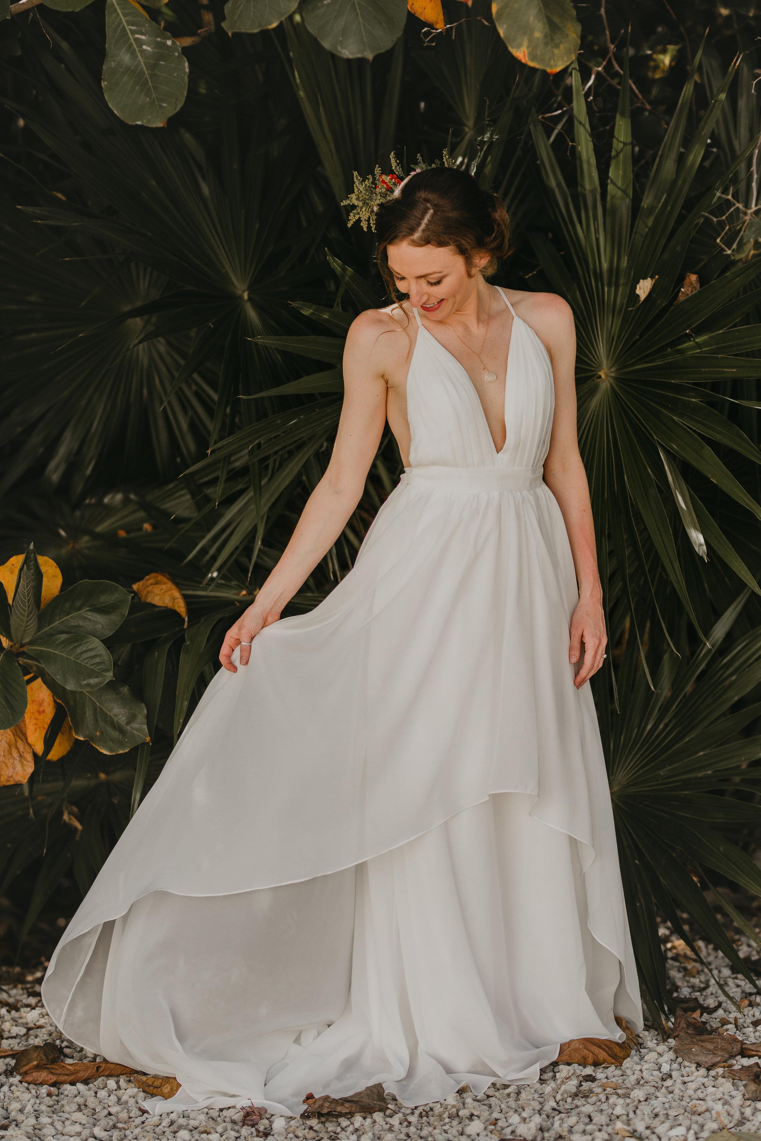 Nicole-Daacke-Photography-beachfront-akumal-destionation-wedding-tulum-mexico-elopement-photographer-destination-wedding-inspiration-sunset-champagne-pop-boho-bride-ocean-tropical-bohemian-tulum-wedding-photos-117.jpg