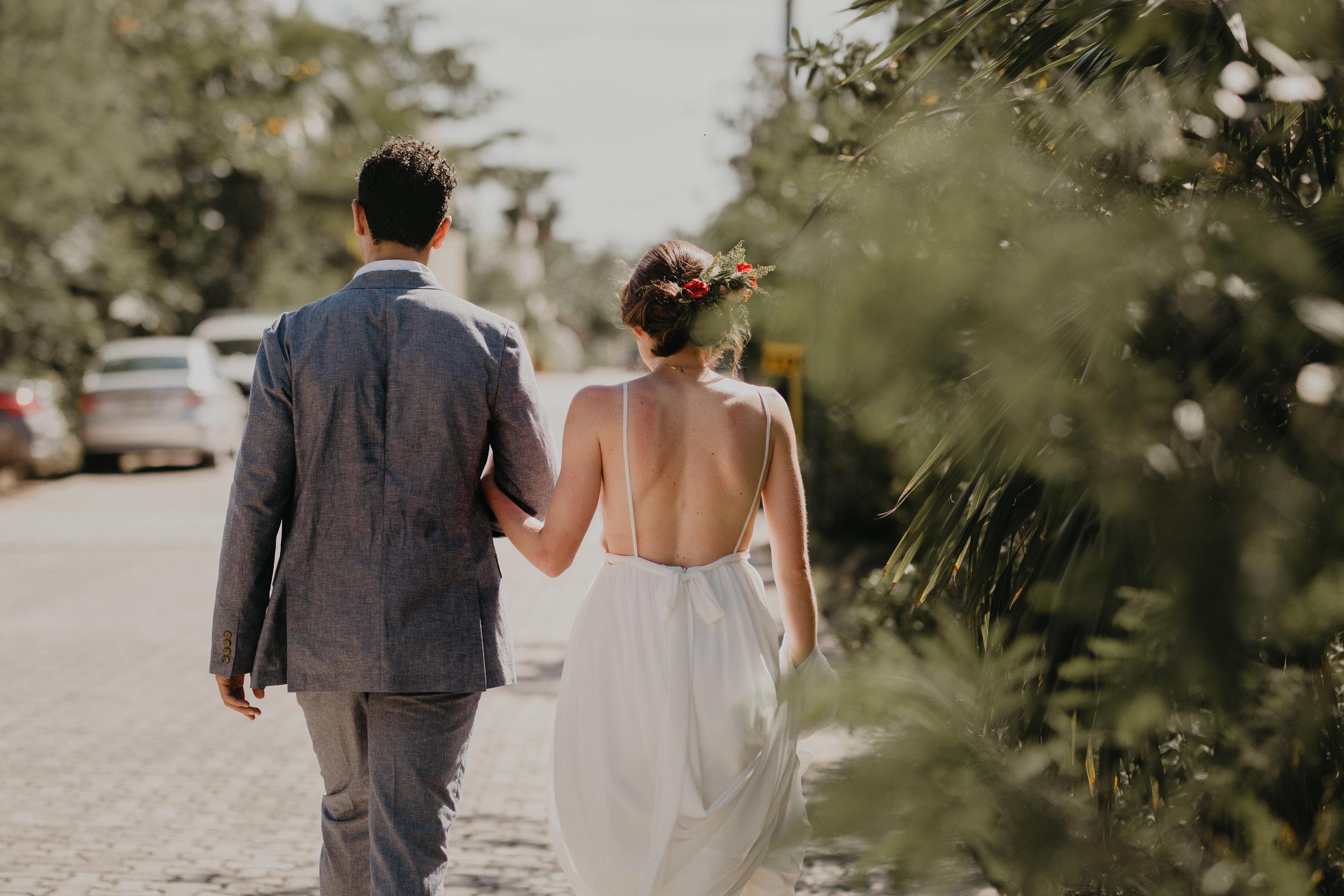 Nicole-Daacke-Photography-beachfront-akumal-destionation-wedding-tulum-mexico-elopement-photographer-destination-wedding-inspiration-sunset-champagne-pop-boho-bride-ocean-tropical-bohemian-tulum-wedding-photos-127.jpg