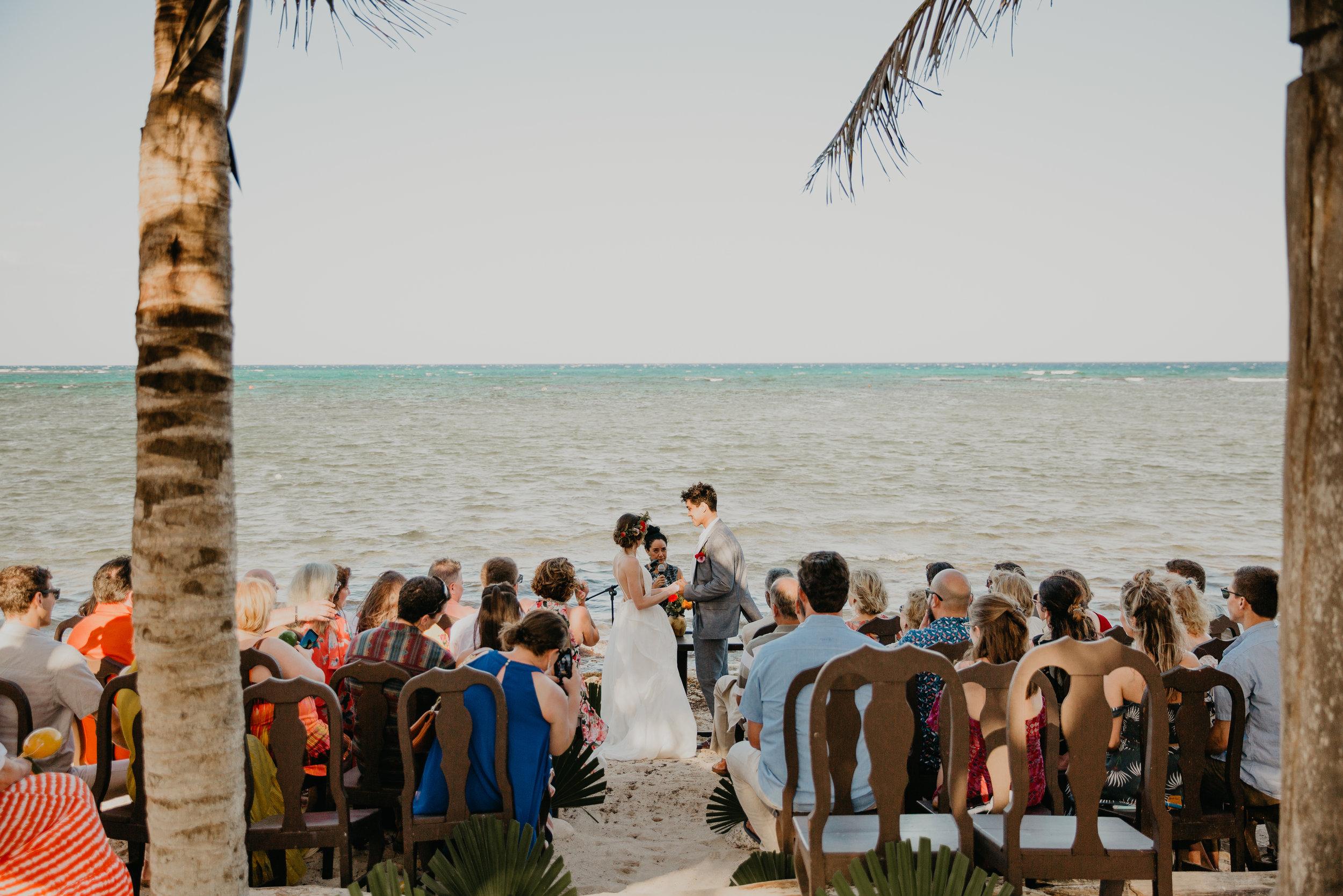 Nicole-Daacke-Photography-beachfront-akumal-destionation-wedding-tulum-mexico-elopement-photographer-destination-wedding-inspiration-sunset-champagne-pop-boho-bride-ocean-tropical-bohemian-tulum-wedding-photos-167.jpg