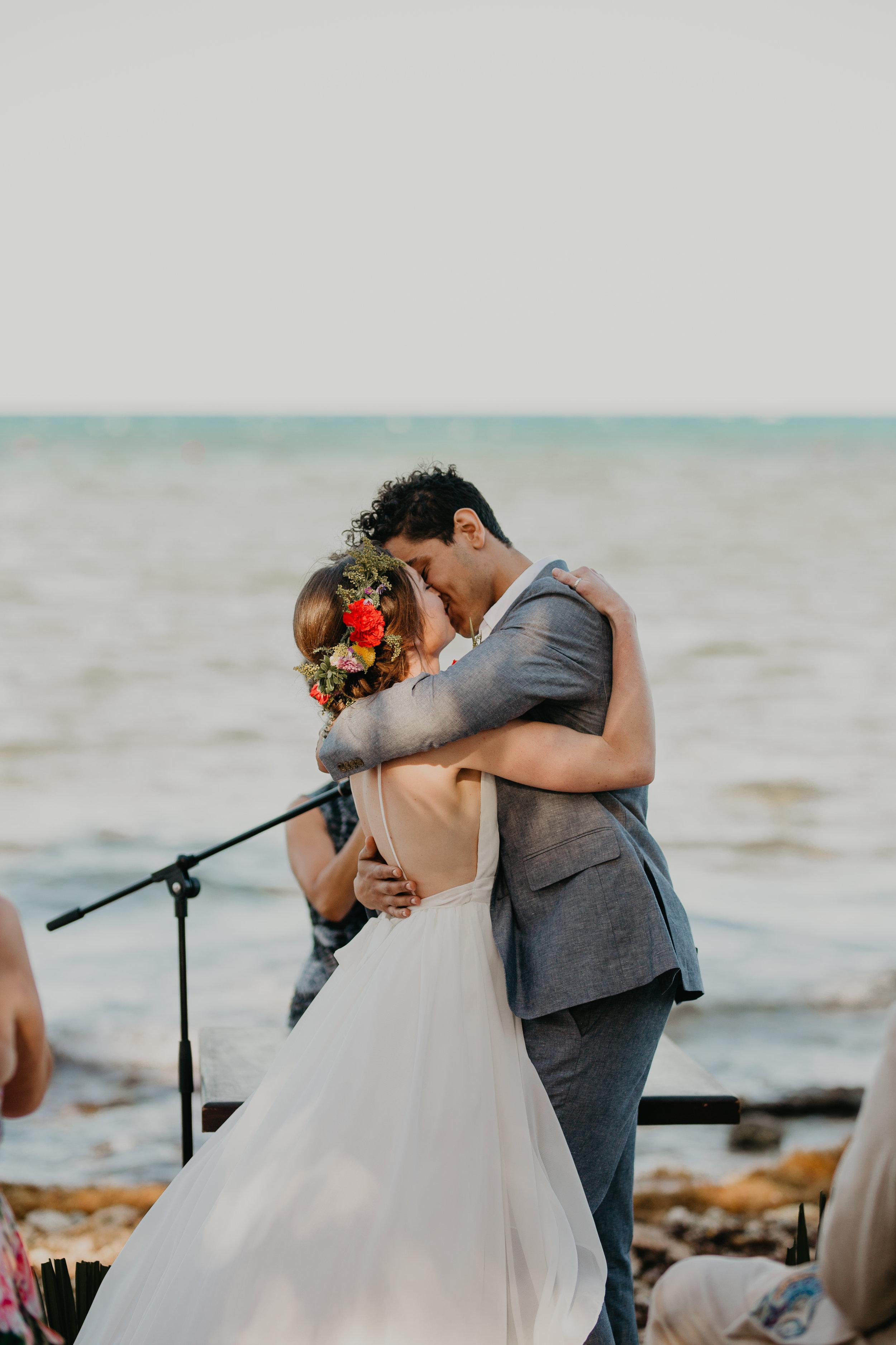 Nicole-Daacke-Photography-beachfront-akumal-destionation-wedding-tulum-mexico-elopement-photographer-destination-wedding-inspiration-sunset-champagne-pop-boho-bride-ocean-tropical-bohemian-tulum-wedding-photos-169.jpg