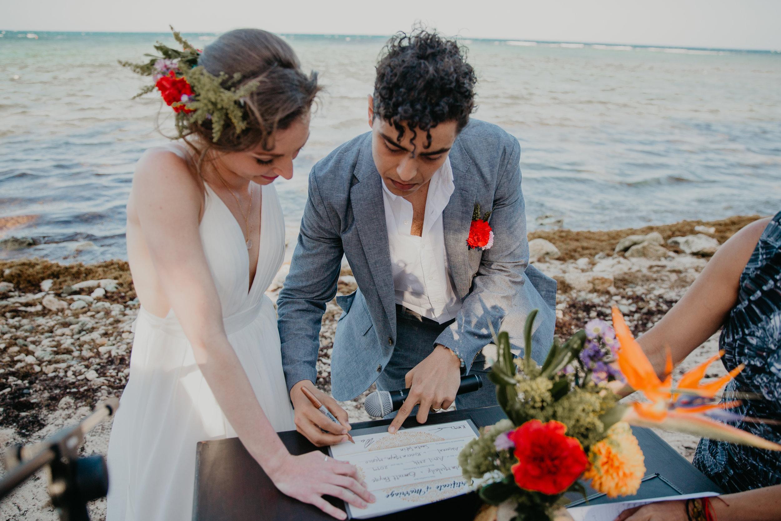 Nicole-Daacke-Photography-beachfront-akumal-destionation-wedding-tulum-mexico-elopement-photographer-destination-wedding-inspiration-sunset-champagne-pop-boho-bride-ocean-tropical-bohemian-tulum-wedding-photos-172.jpg