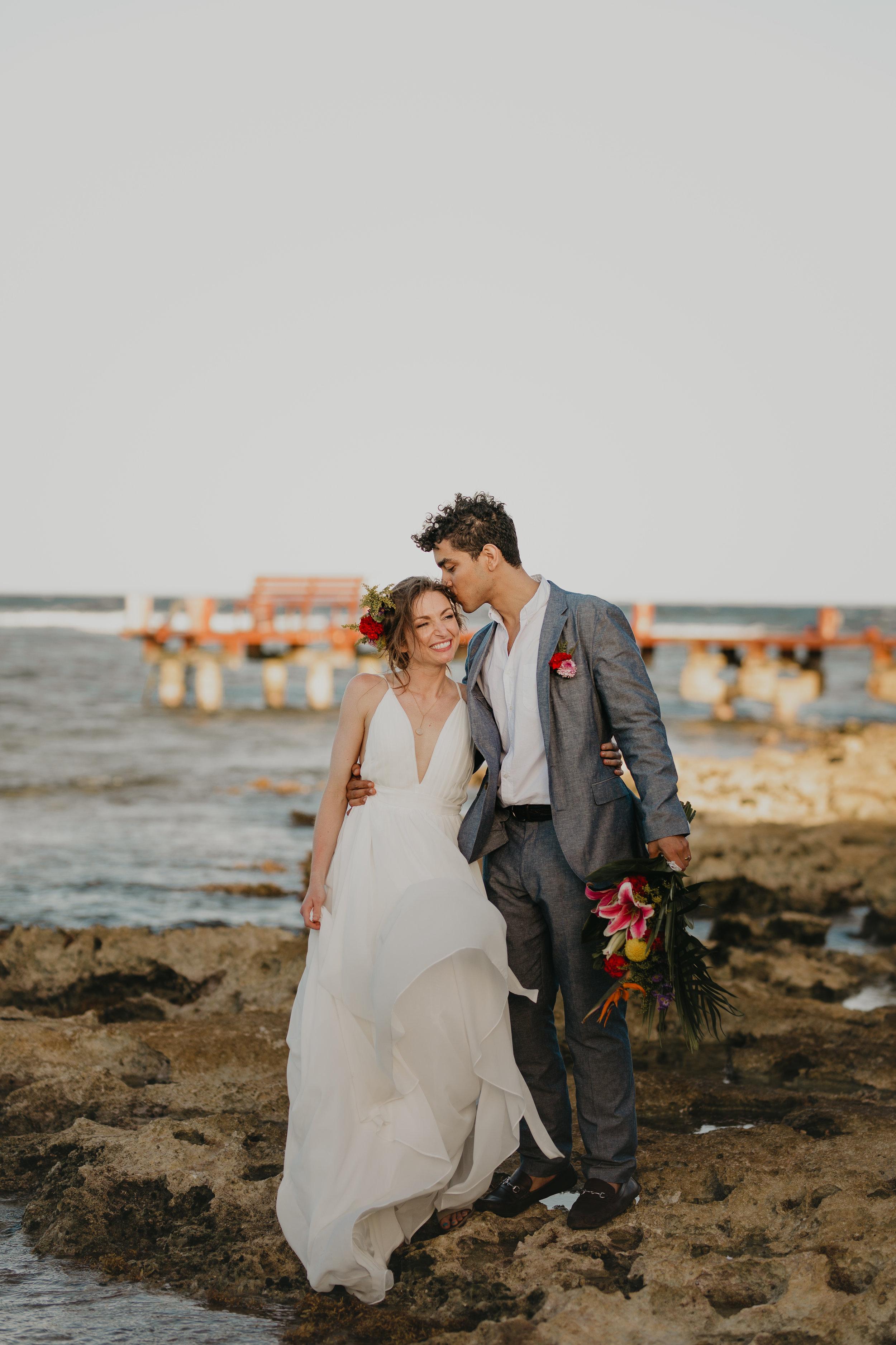 Nicole-Daacke-Photography-beachfront-akumal-destionation-wedding-tulum-mexico-elopement-photographer-destination-wedding-inspiration-sunset-champagne-pop-boho-bride-ocean-tropical-bohemian-tulum-wedding-photos-180.jpg