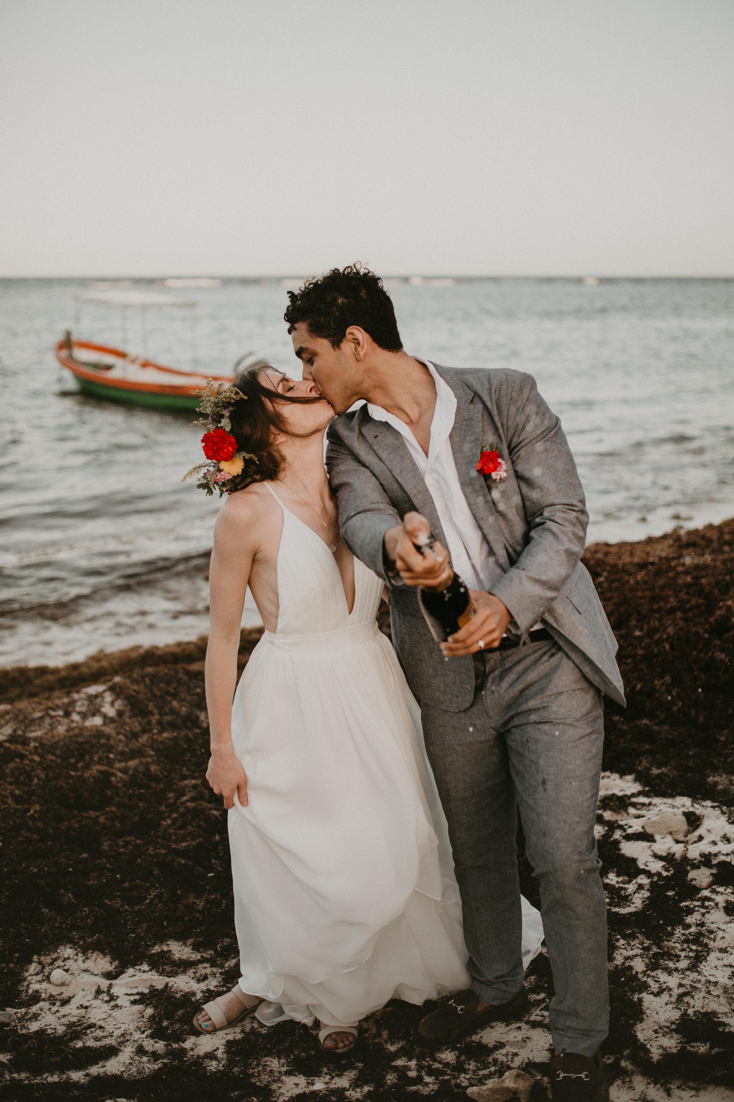 Nicole-Daacke-Photography-beachfront-akumal-destionation-wedding-tulum-mexico-elopement-photographer-destination-wedding-inspiration-sunset-champagne-pop-boho-bride-ocean-tropical-bohemian-tulum-wedding-photos-195.jpg
