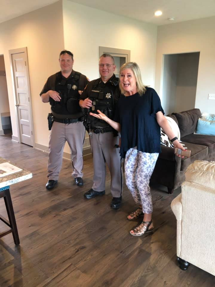 Cindy Maher Smiling with omaha Police Officers