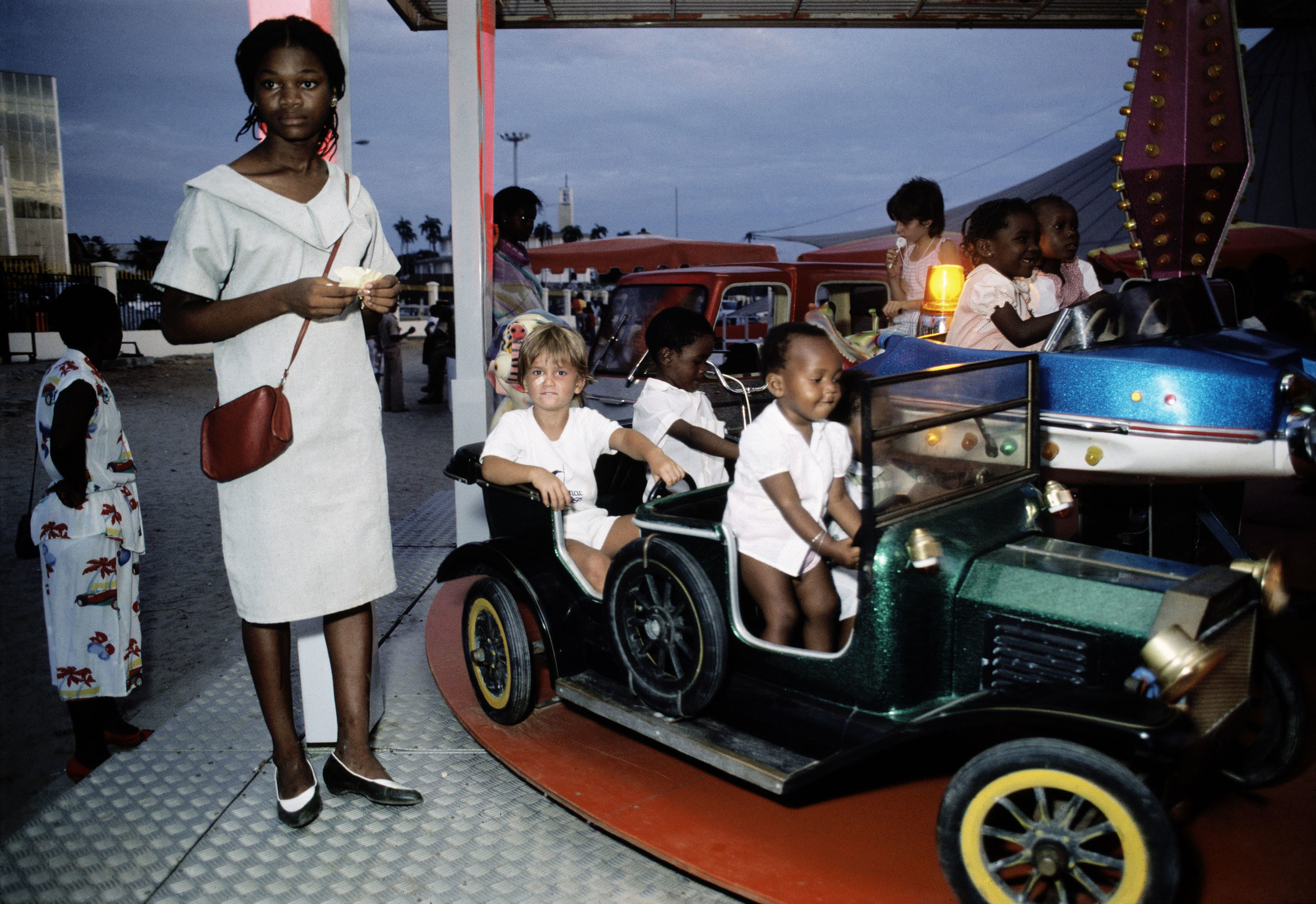 Car ride at a childrens amusement | Bruno Barbey