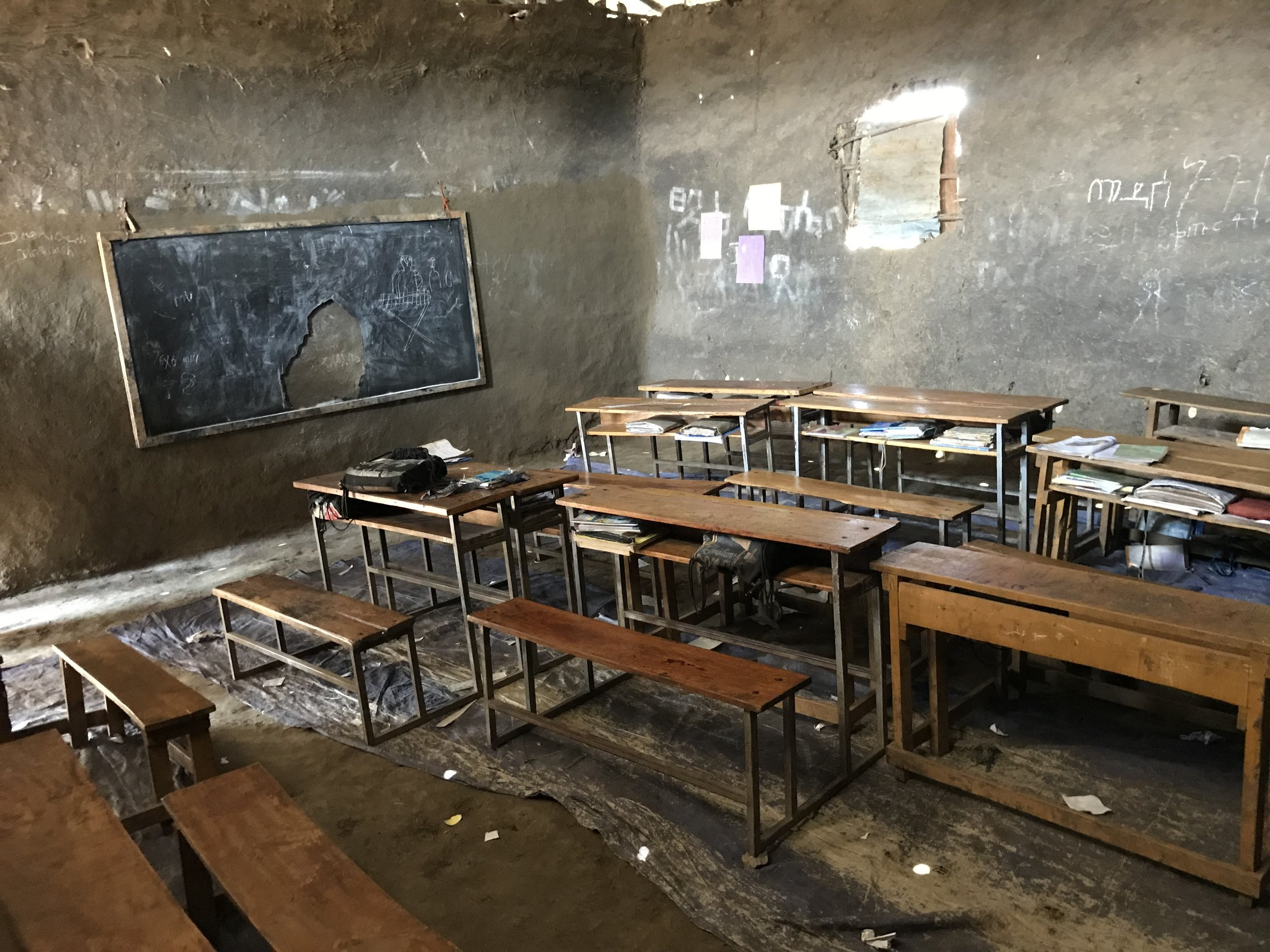 A classroom at the Fule school. In addition to providing concrete floors for nine rooms, Friends of Homacho will purchase new blackboards for each classroom.