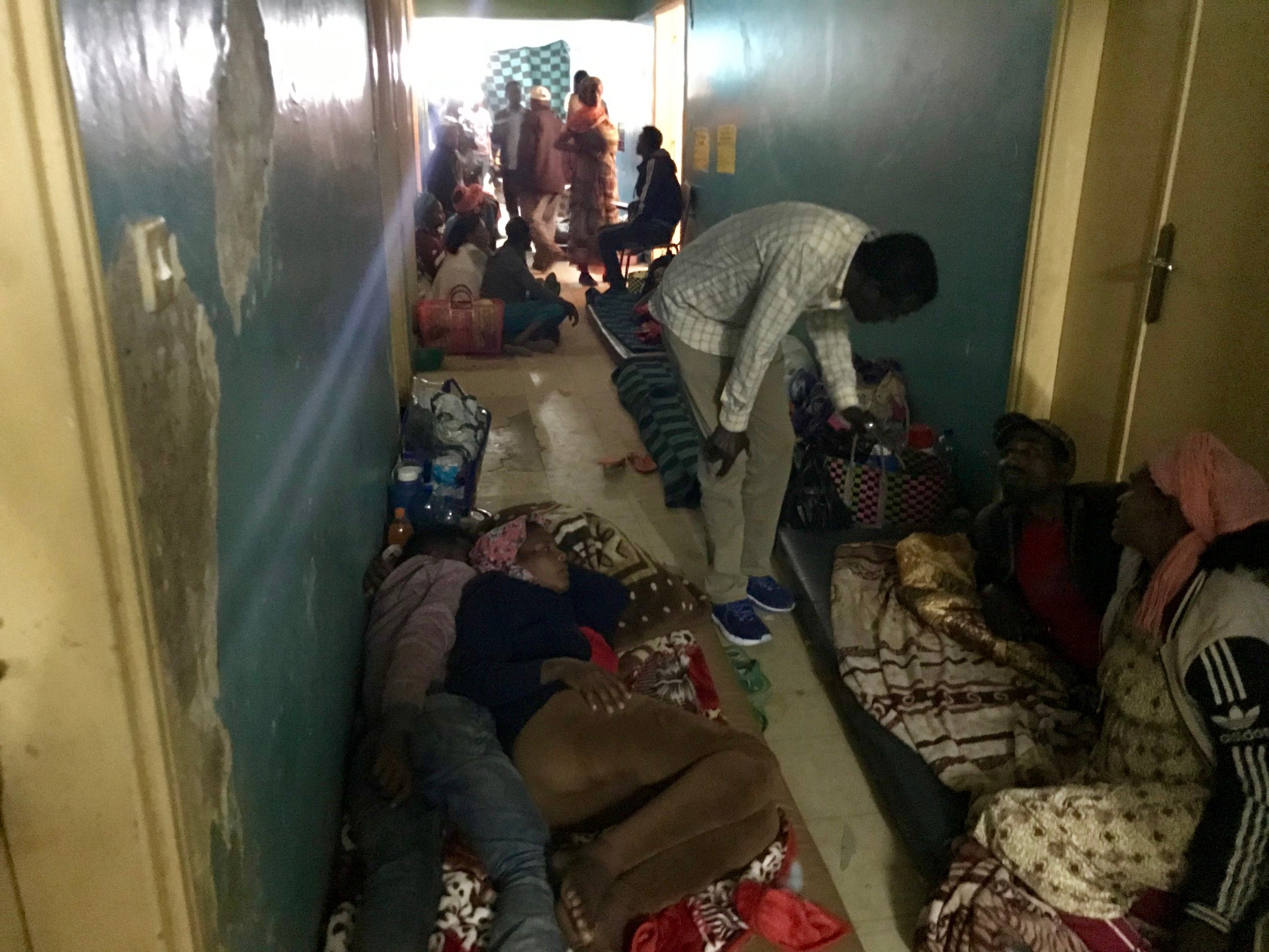Patients were lined along the hallways on mattresses because there were no beds in the wards.