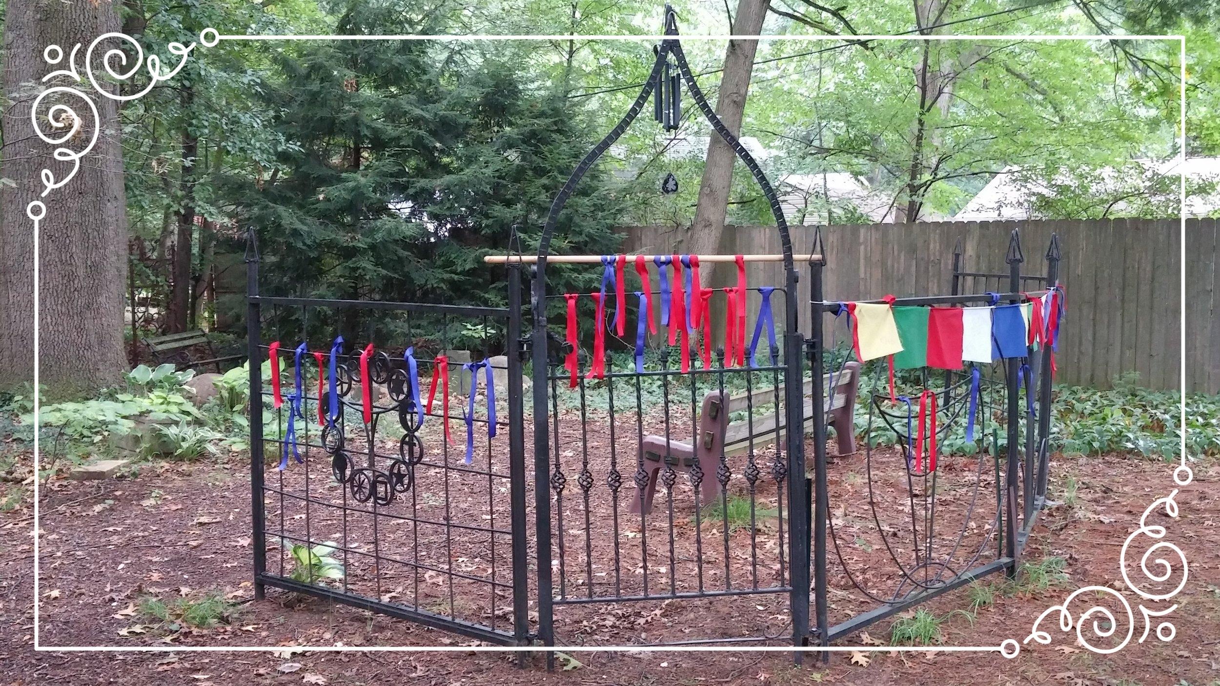 prayer ribbons on gate.jpg
