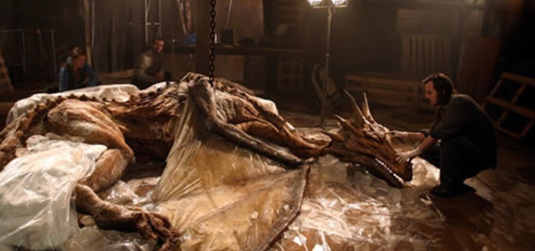 Fig. 1 - A frame of  The Last Dragon  showing Dr. Tanner analyzing the recently rediscovered skeleton of a female dragon.