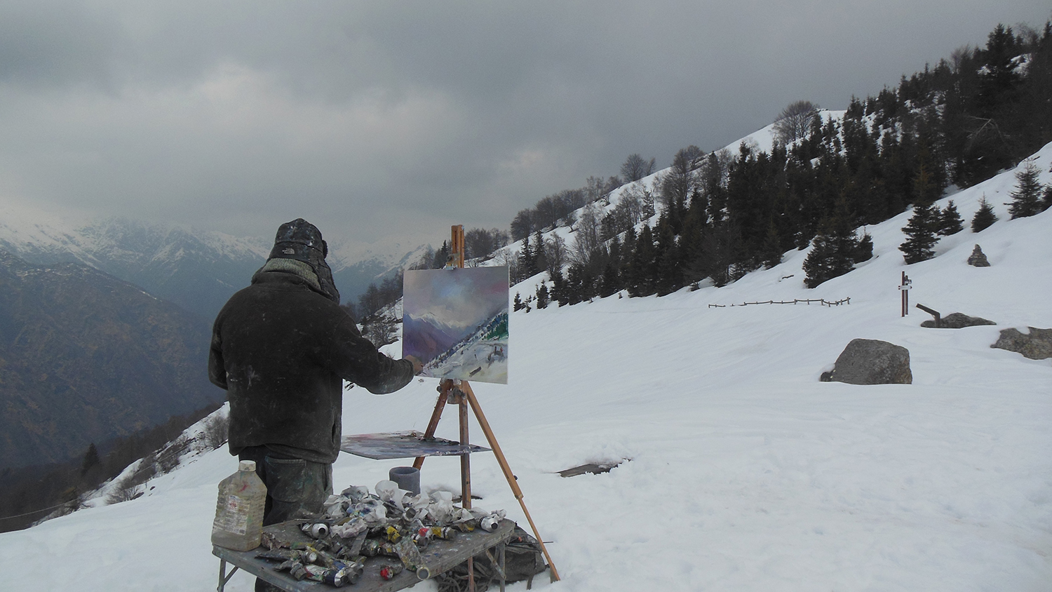 Painting the stunning, panoramic view towards Monta Rosa from Mosso in Italy. It looks a lot colder that it actually was. It was so quiet too. This is my second trip to this region of Piedmont in Northern Italy and the winter conditions have provided a much different experience and challenge from the ones encountered last spring. I am here for a few weeks to further explore the region and revisit some of the places that inspired me last time. ( daivd-atkins.com ).  My thanks to Manuel Capella for sending me the photo.