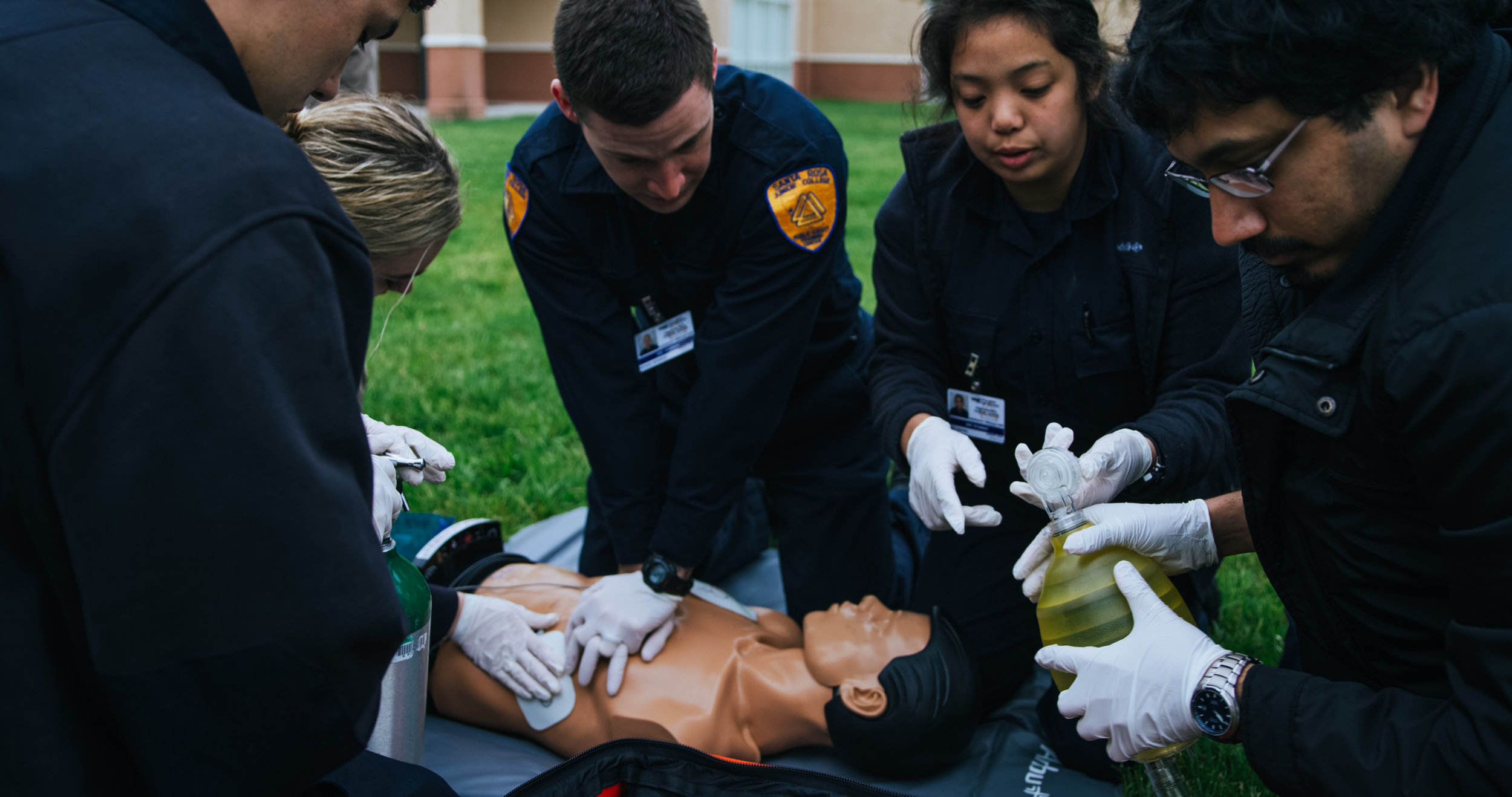 Emergency response students practicing on dummy in field