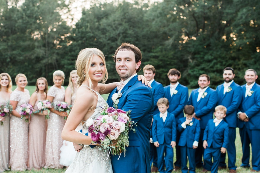 """September 23, 2017  When Eden approached us about her wedding, we instantly fell in love with her ideas, her family, and her wedding location. It was a dream to work alongside them for 9 months, planning and finalizing all details, styling and creating. These weddings are ones that wedding professionals don't forget.  The vendors who worked with us were amazing, and though they probably thought more once """"this lady is off her rocker,"""" they each exceeded the expectations of their commitments and made this day perfect.  Vendors:  Photographer-Lindsay Vallas  Videographer-Revival House  Hair & Makeup-Kate Vanlandingham - Stella Salon  Tents & Rentals-Mississippi Tent  Tent Draping-Magnolia Rental & Sales  Lighting-Gulf South Productions  Lounge Furniture and Accents Rental-Parlours  Restroom Trailers & party bus-Sheffield Rentals  Live Artist-Sam Beiber  Band-NOLA Dukes Band  Ceremony Musicians-members of Mississippi Symphony Orchestra  Fireworks-Coach's Fireworks  Trolley-Phoenix Transportation  Specialty Cookies-Southern Sweets by Carla AND Claudia Eichelberger  Getaway Car-Tom & Peggy Yates  Catering-McClain Lodge  Florals, Styling, Décor, Cakes, Directing & Coordination- OAK (Bespoke Wedding Plan)  Invitations, Fan programs, Menus- Eric Ashley Designs for OAK"""