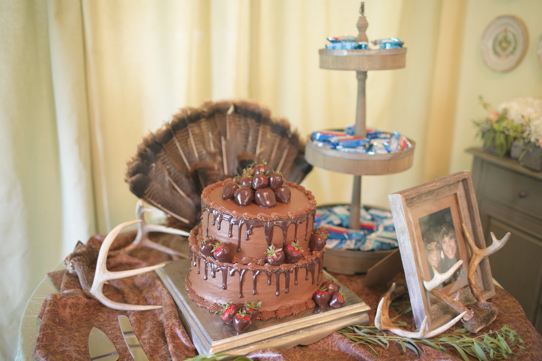 The yummy chocolate and strawberry groom's cake was the centerpiece to a table full of memorabilia from Jennings' life; his trophies, his favorite drinks, and his favorite snacks!