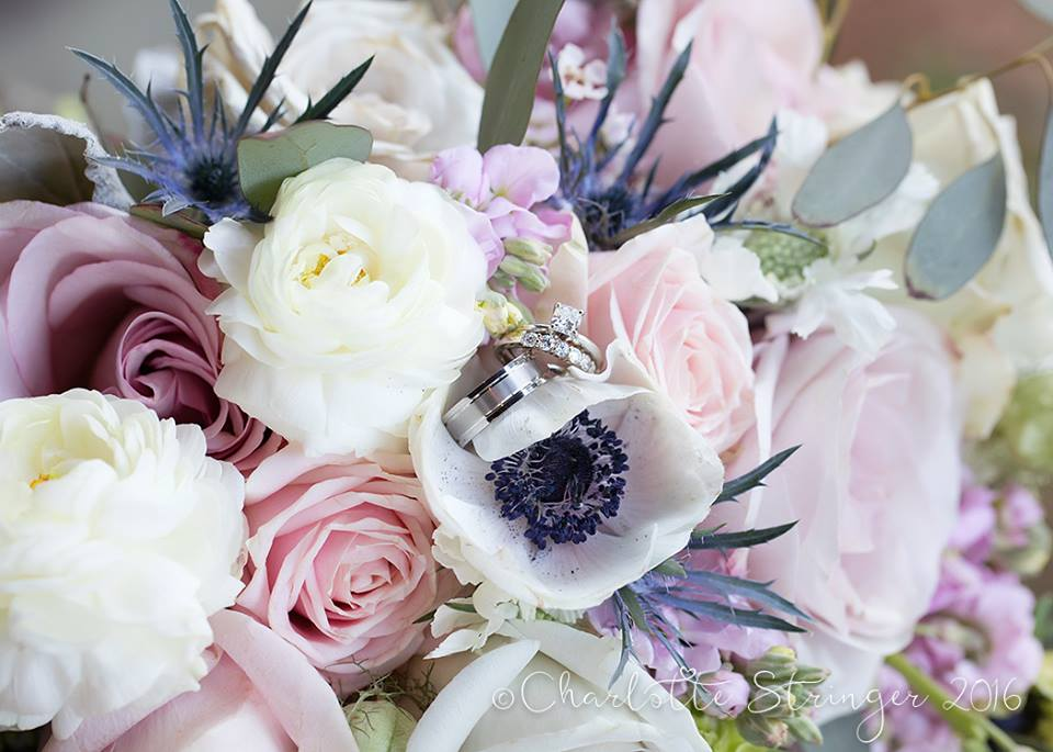 wedding rings with pink and purple flowers.jpg