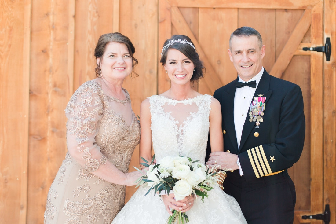 bride with parents picture.jpg