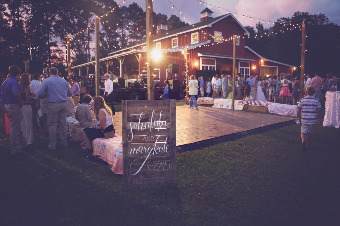 outdoor reception with red barn.jpg