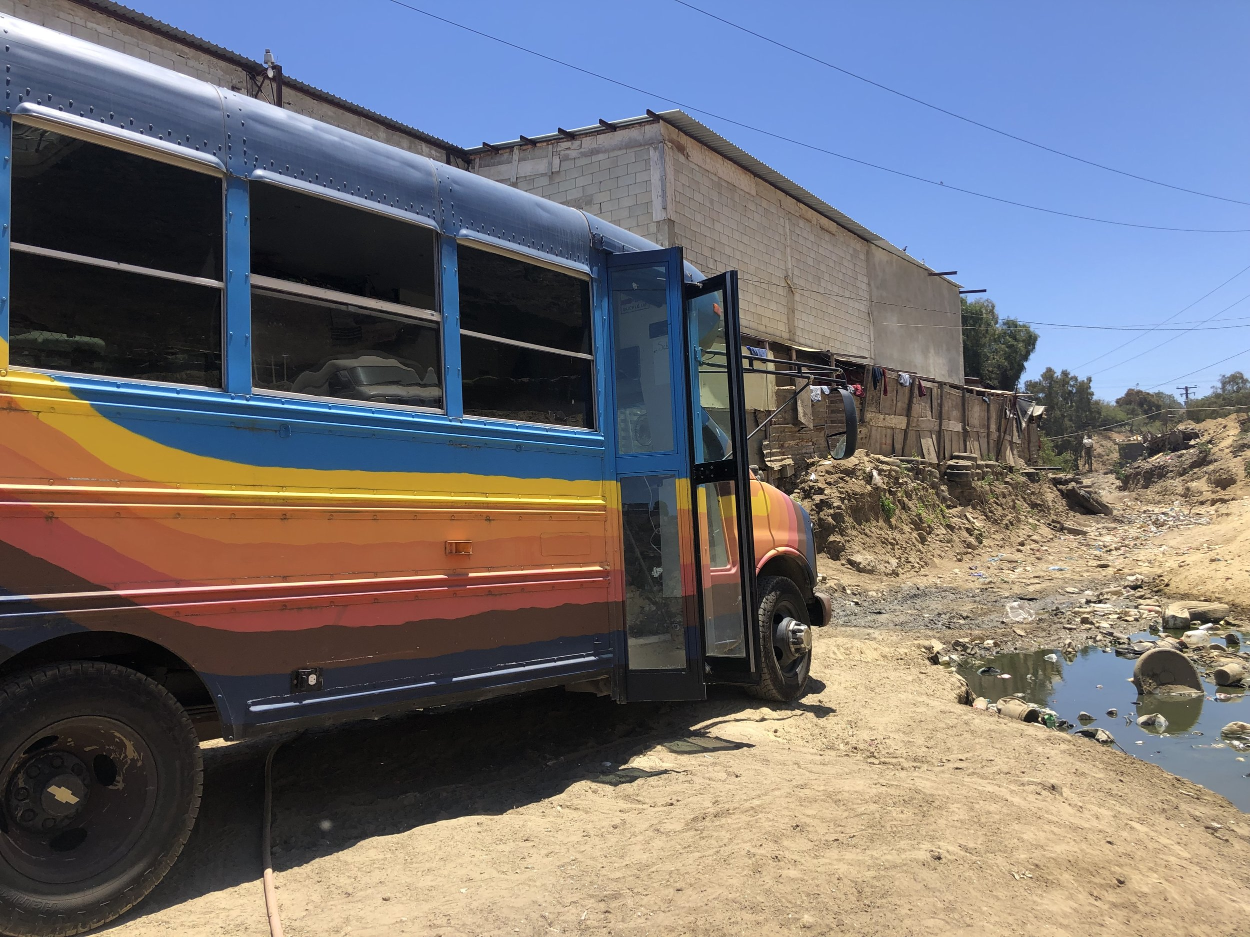 The Skoolie at one of the three shelters on our weekly route in Tijuana