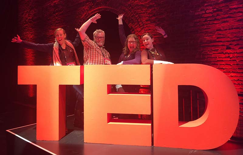 The TEDxMcMinnville team snuck on stage for a pic with the TED logo!
