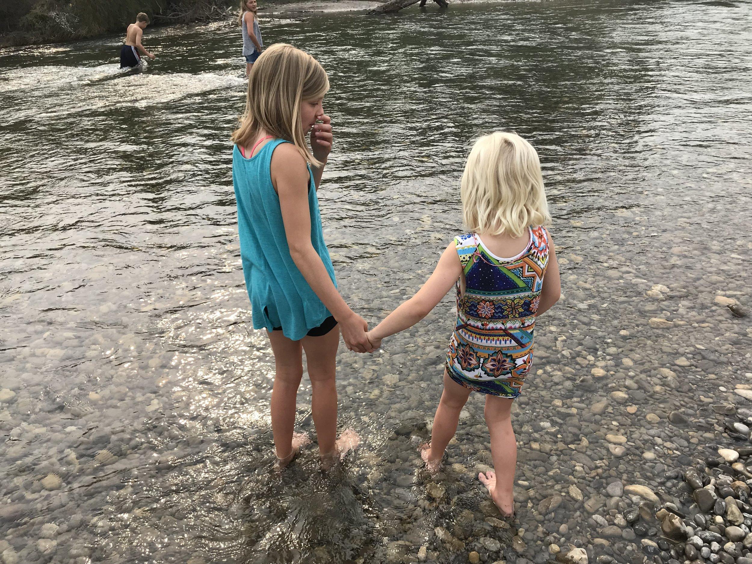 Zoe & Kiara wading in Elbow River, Calgary.