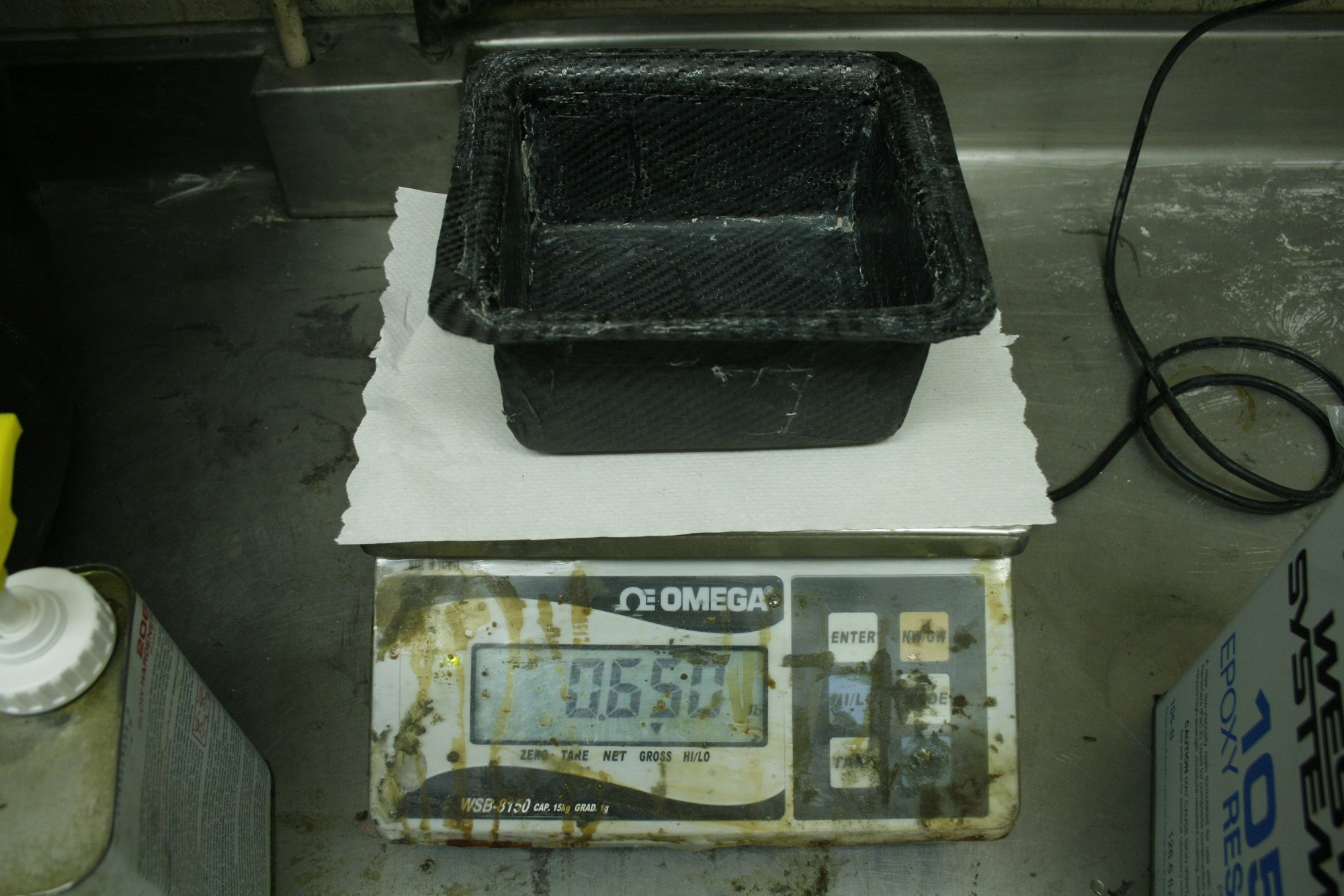 An older mold being weighed