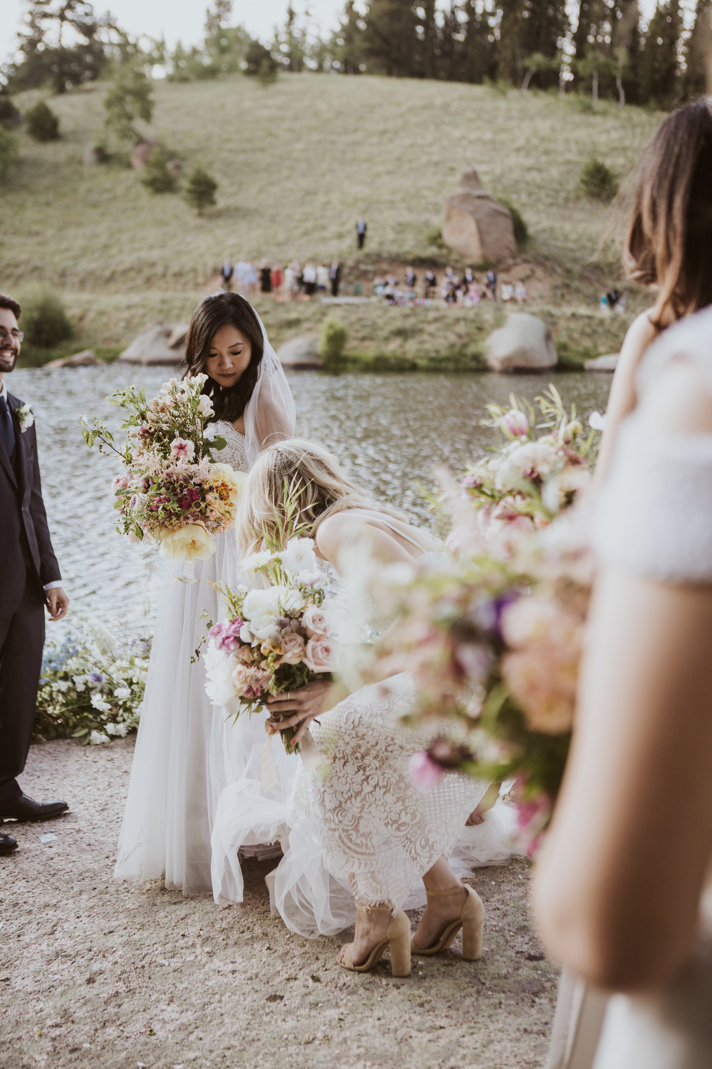 Wedding in the mountains, surrounded by water, wildflowers, and butterflies. Guests were seated across the river to take in the beautiful ceremony on the rock.