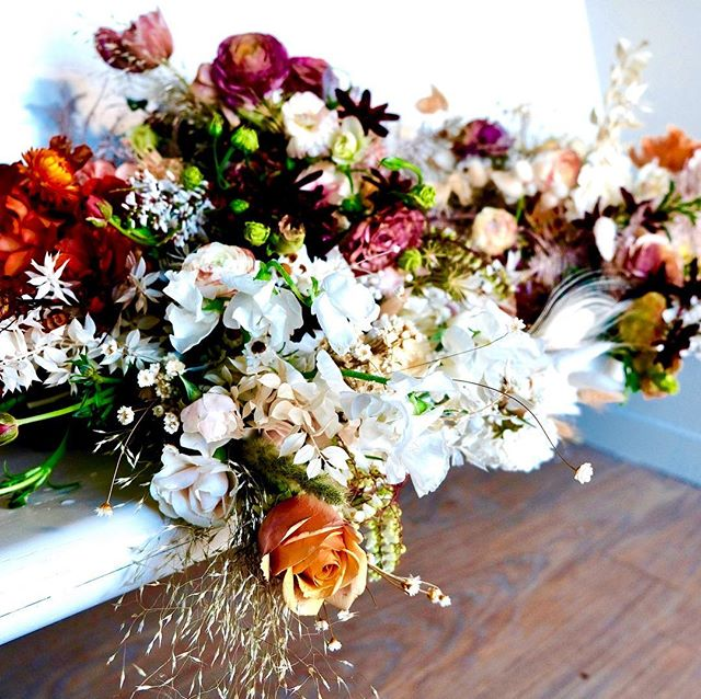 "Jordan's earthy, nature-driven palette. What a pleasure it was to work with all of these indecipherable colors and materials— russet and ochre, tawny neutrals and cappuccino browns, apricot and fig, all expressed through dried and foraged materials as well as perfect cut flowers. We wanted the flowers to feel as though they'd been foraged in nature; wanted them to have a kind of immediacy to them, as though they had just been gathered in a moment of joy. We were after colors that aren't quite colors— intangibles that are found only in nature. And we wanted the kind of flowers you can only find off-the-beaten path; the rare and unusual finds that all foragers long for, knowing that ""the relentless complexity of the world is off to the side of the trail"" (Gary Snyder). In the end, these florals were a reflection of Jordan's beautiful disposition— earthy, organic, joyful, and free.  The highlight of the floral designs, for me, was the of dried materials, which felt extra ethereal. As I worked with star flower and winged everlasting, I was reminded of lines of a favorite poem which depict white tufts of milkweed floating ""anonymous as cherubs"" over a meadow. It felt so right to tuck these tiny white flora into tall, swaying grasses and intricate bouquets. I yearn for opportunities to use things like bunny tail, dune grass, nigella pods, bleached amaranth, star flowers— nuanced, tiny, textural things that fascinate me. And here I was given the liberty to use anything I pleased, to find source and forage whatever felt most natural and creatively appropriate.  It will take me several posts to give a true sense of these florals, given the range of colors and materials and complexities involved. But as I share the photos, I hope you can see and sense how entirely at ease I was with this project. How moved by Jordan's kindness and her total trust in me. Designing has rarely felt so easy, and so close to my own personal experiences in nature. Thank you, Jordan, for gracing my life and my creative process; you made it all so easy. I hope these florals added beauty to your day and a little blessing for the path ahead. 🕊"