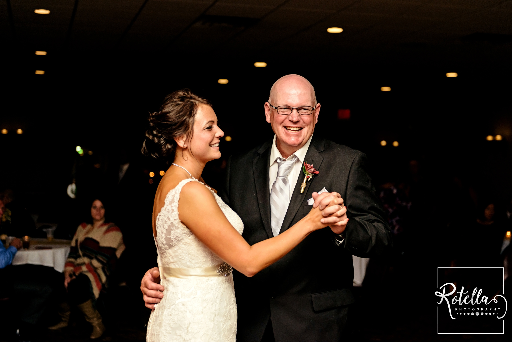 Father and bride smiling while dancing with daughter - Rotella Photography